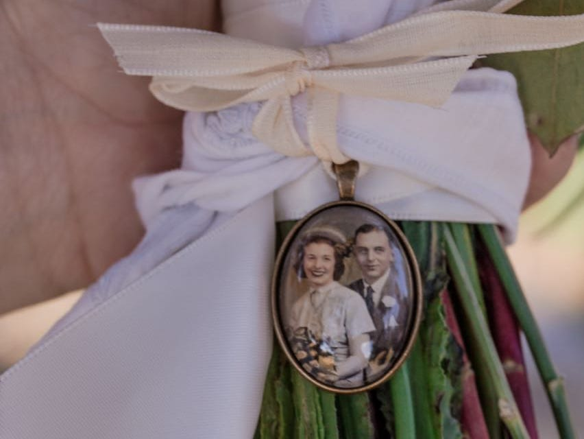 Emily Mannis tied a photo of her grandparents on their wedding day to her bouquet when she married Patrick Dougherty.