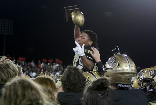 Rider's Tre Byrd is held by his teammates after the Raiders regional title win over Lubbock Cooper Thursday, Dec. 6, 2018, at Wildcats Stadium in Abilene. The Raiders defeated the Pirates 38-35.
