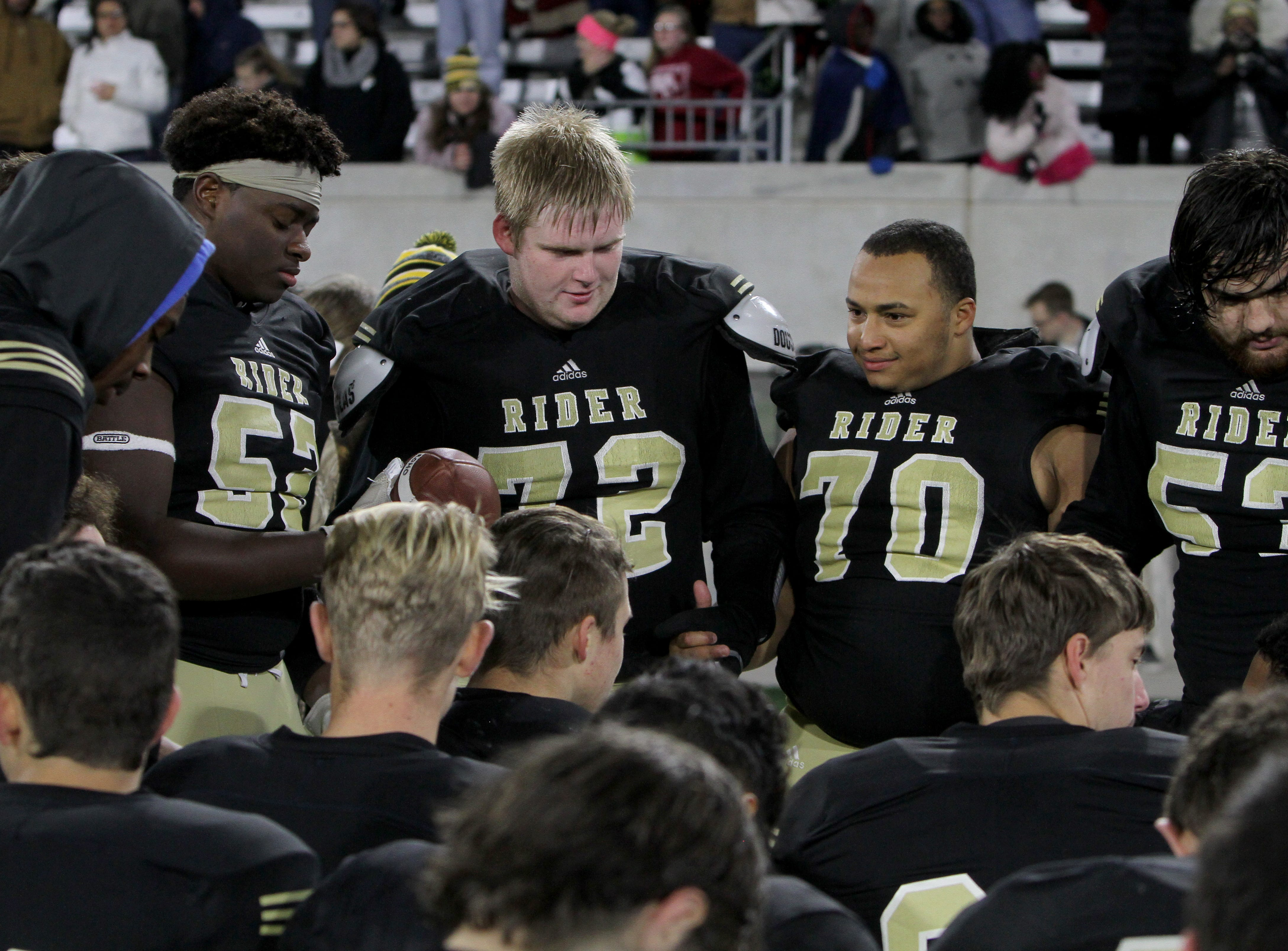 Rider's Taikorean Phillips, left, Dawson Hale, Aaron Matthews and Jr Ewing are part of the offensive line that was given the game ball after the Raiders win over Lubbock Cooper Thursday, Dec. 6, 2018, at Wildcats Stadium in Abilene. The Raiders defeated the Pirates 38-35.