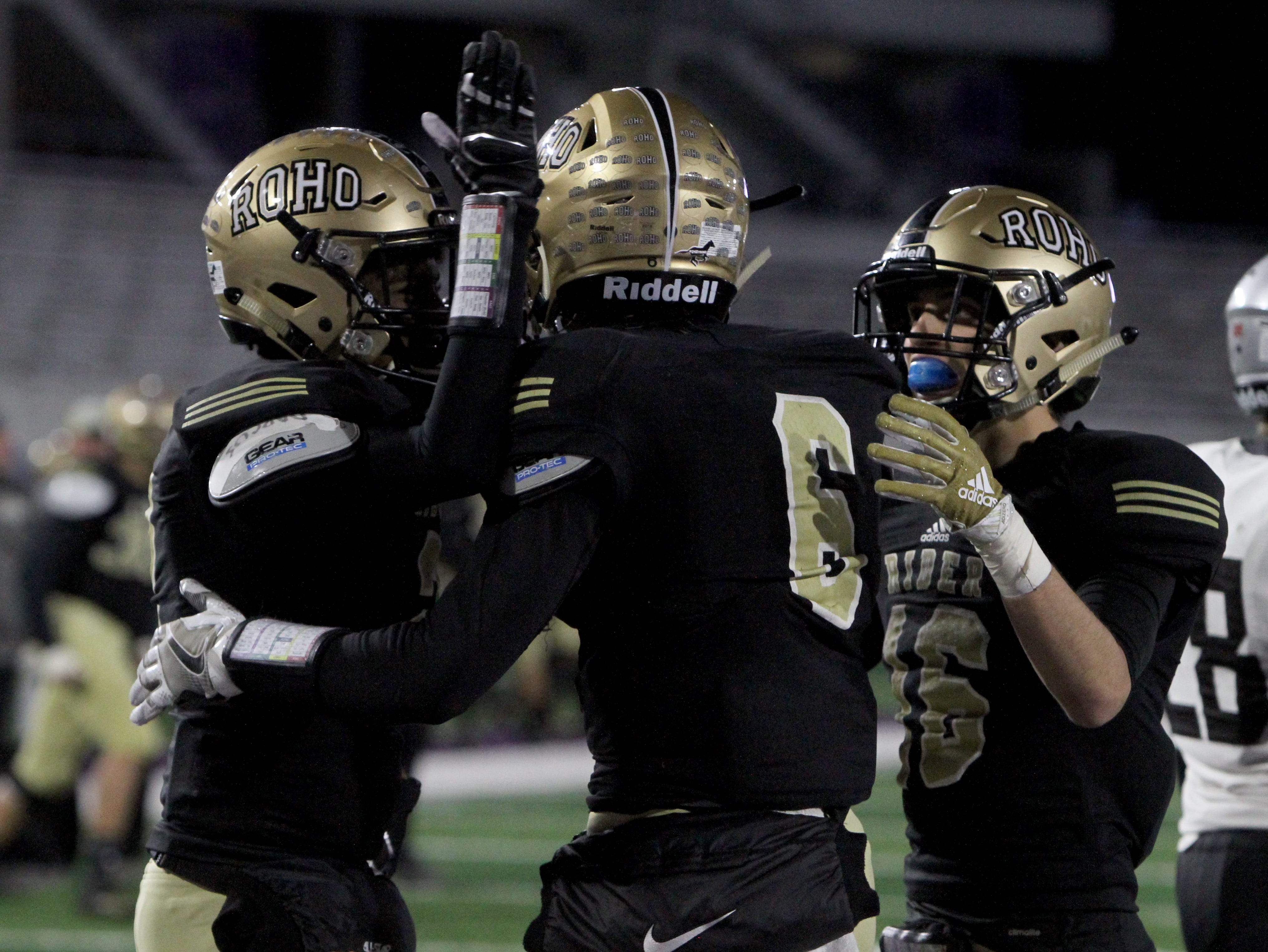 Rider's Nick Darcus, left, Noah Randall celebrate Ranse Radtke (6) touchdown catch against Lubbock Cooper Thursday, Dec. 6, 2018, at Wildcat Stadium in Abilene.