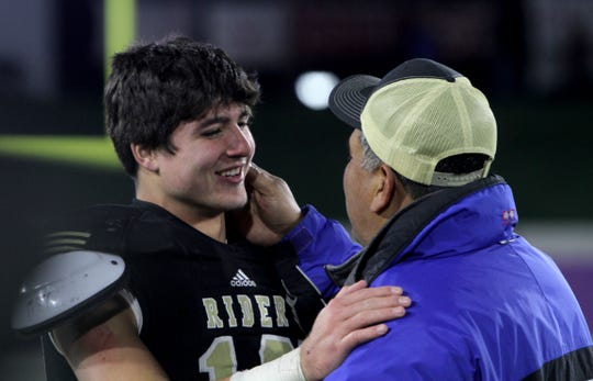 Rider's Jacob Rodriguez talks with his father Joe after the Raiders regional title win over Lubbock Cooper Thursday, Dec. 6, 2018, at Wildcats Stadium in Abilene. The Raiders defeated the Pirates 38-35.