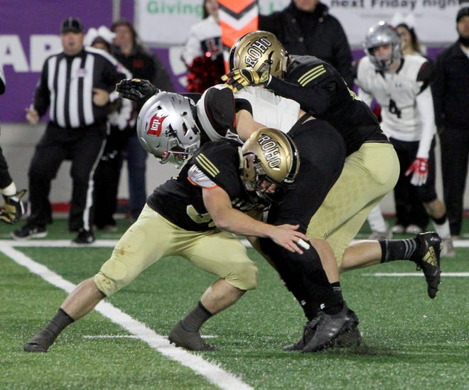 Rider's Bodie Oliver tackles Lubbock Cooper's Brenden Mehl Thursday, Dec. 6, 2018, at Wildcats Stadium in Abilene. The Raiders defeated the Pirates 38-35.