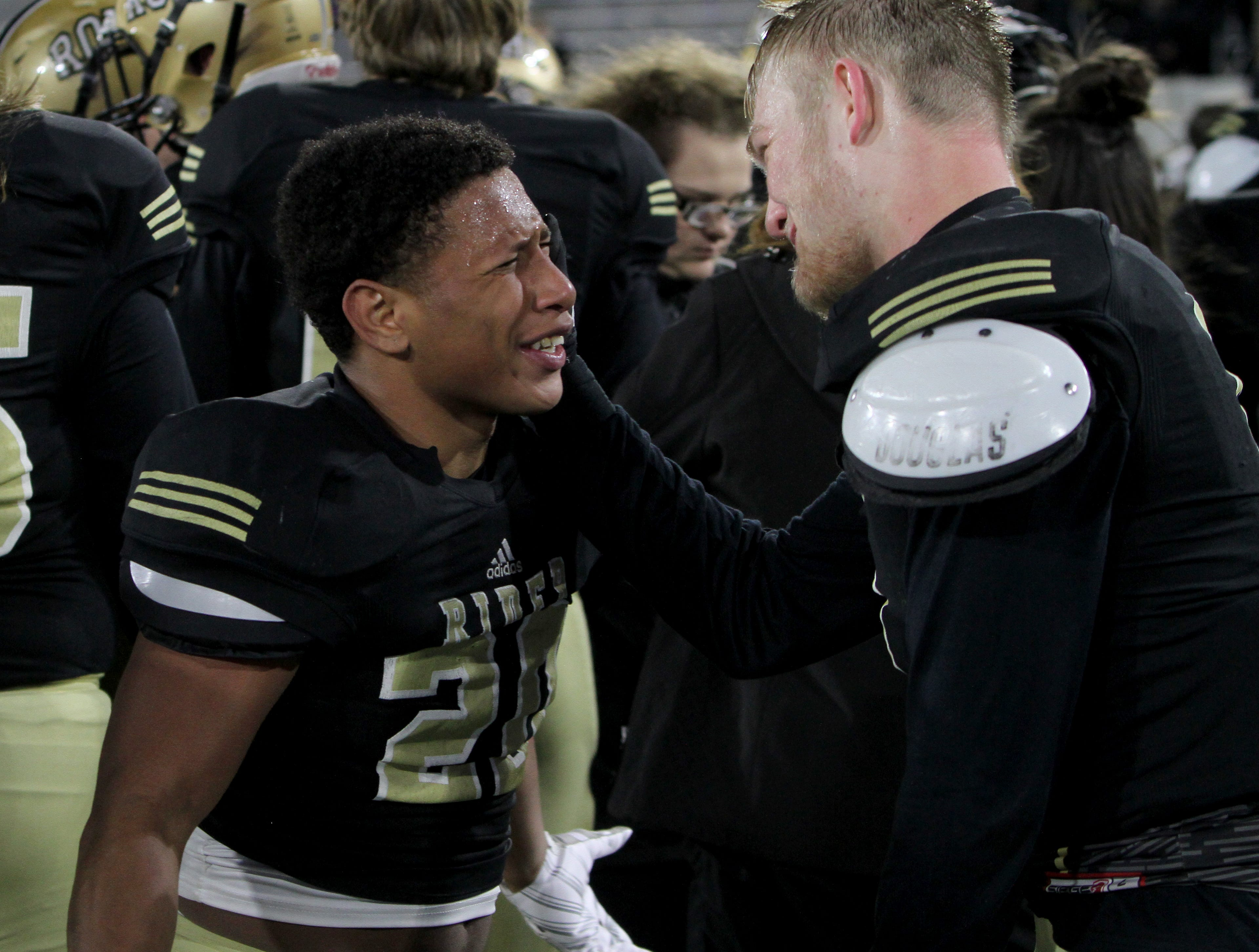Rider's Tre Byrd celebrates with Jack Hatch after the Raiders regional title win over Lubbock Cooper Thursday, Dec. 6, 2018, at Wildcats Stadium in Abilene. The Raiders defeated the Pirates 38-35.