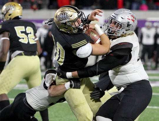Rider's Jacob Rodriguez is tackled by Lubbock Cooper defenders Thursday, Dec. 6, 2018, at Wildcat Stadium in Abilene.