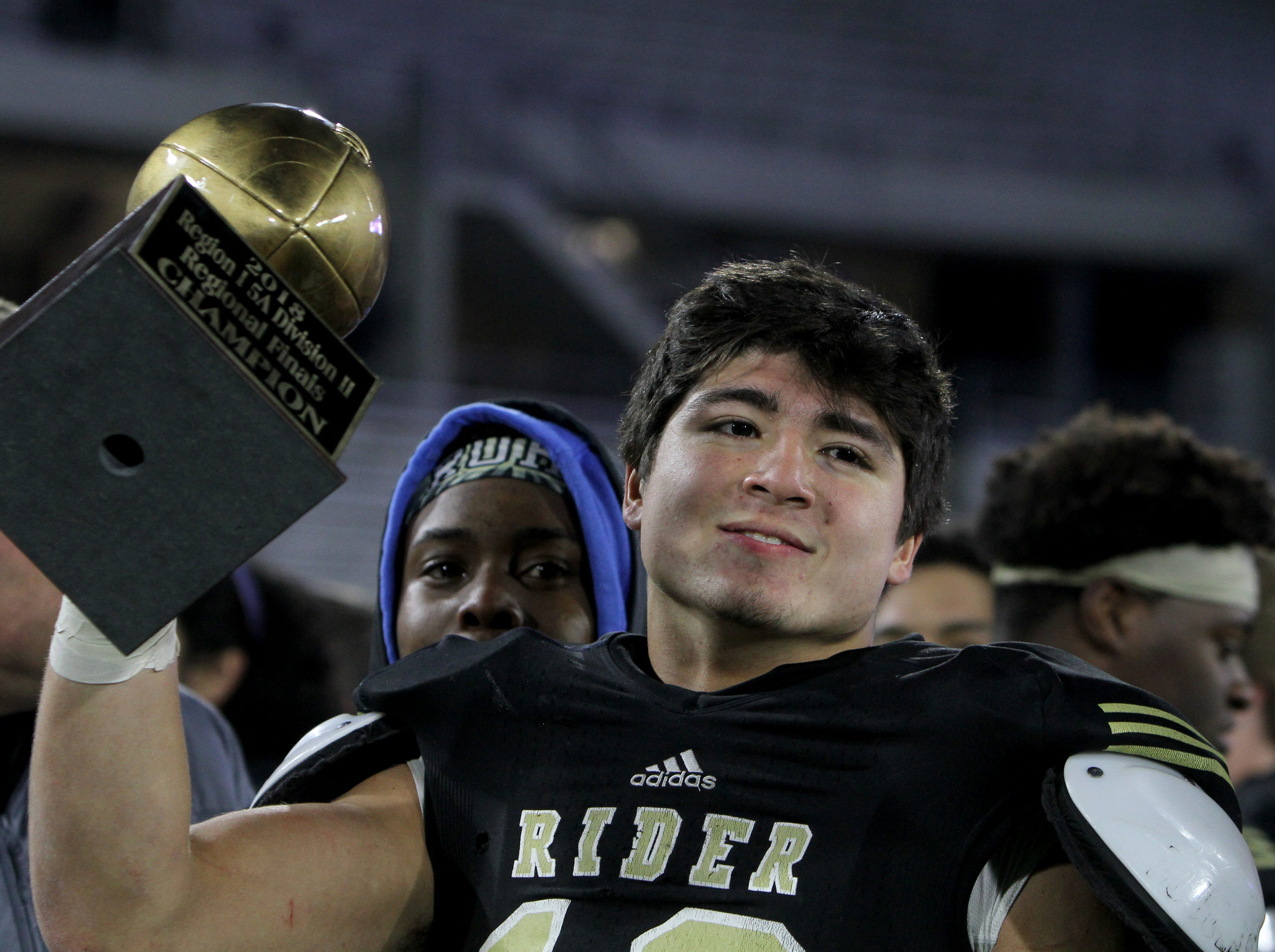 Rider's Jacob Rodriguez holds up the golden ball after the Raiders win over Lubbock Cooper Thursday, Dec. 6, 2018, at Wildcats Stadium in Abilene. The Raiders defeated the Pirates 38-35.