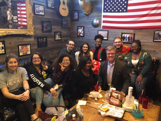 The Wichitan staff members, gathered at their end-of-year party at Backporch Drafthouse on Dec. 5, 2018, was recently  named a finalist for the Pacemaker Award, given to the top collegiate newspapers in the country. Pictured left to right: Carli Woolsey, Alyssa Mitchell, Simoné Norfleet, Jason Wilson, Brittni Vilandre, Angel Ukwitegyetse, Chloe Phillips, Bradley Wilson, Stephen Gomez, and Aquila Freeney.