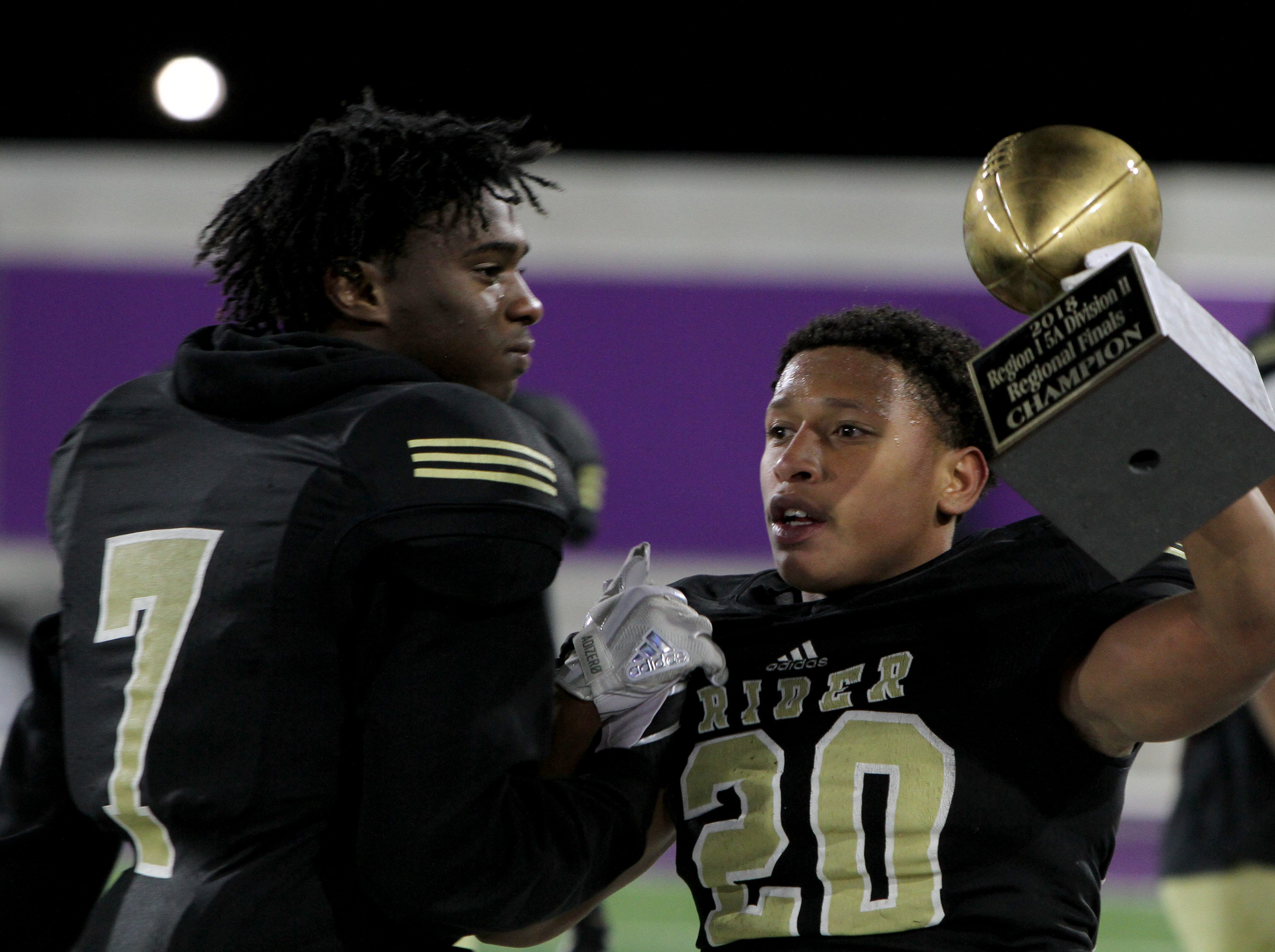 Rider's Tre Byrd celebrates the Raiders win over Lubbock Cooper with Patrick Cyrus (7) Thursday, Dec. 6, 2018, at Wildcats Stadium in Abilene. The Raiders defeated the Pirates 38-35.