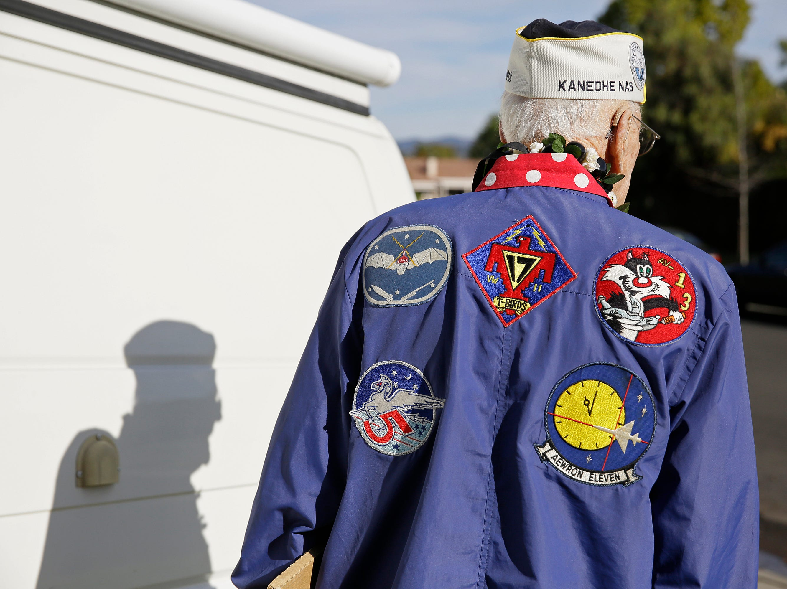 Don Long walks out to his camper van at his home Friday, Dec. 7, 2018, in Napa, Calif., before driving to attend a number of Pearl Harbor remembrances. Retired U.S. Navy Cmdr. Don Long wasn't at Pearl Harbor when Japanese war planes started bombing Hawaii on December 7, 1941, he was on the opposite side of Oahu standing watch aboard an anchored military seaplane in Kaneohe Bay. But the wave of bombs and bullets reached his military installation soon after Pearl Harbor was struck, and the young sailor watched from afar as buildings and planes started to explode all around him. On the 77th anniversary of the attack, Long will remember from his home where the 97-year-old survivor will reflect and honor those who died.
