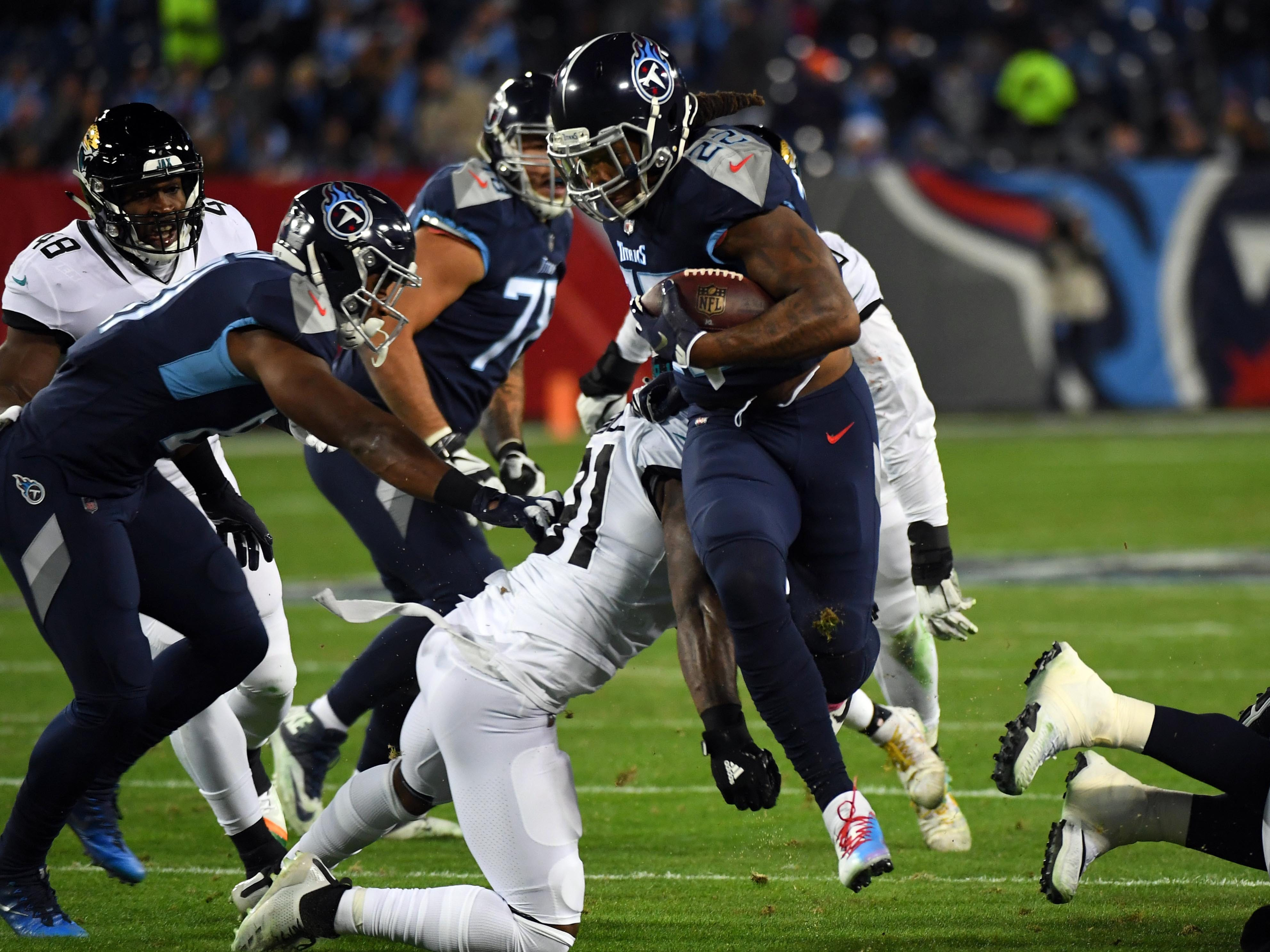 Tennessee Titans running back Derrick Henry runs for a short gain during the first half against the Jacksonville Jaguars at Nissan Stadium.