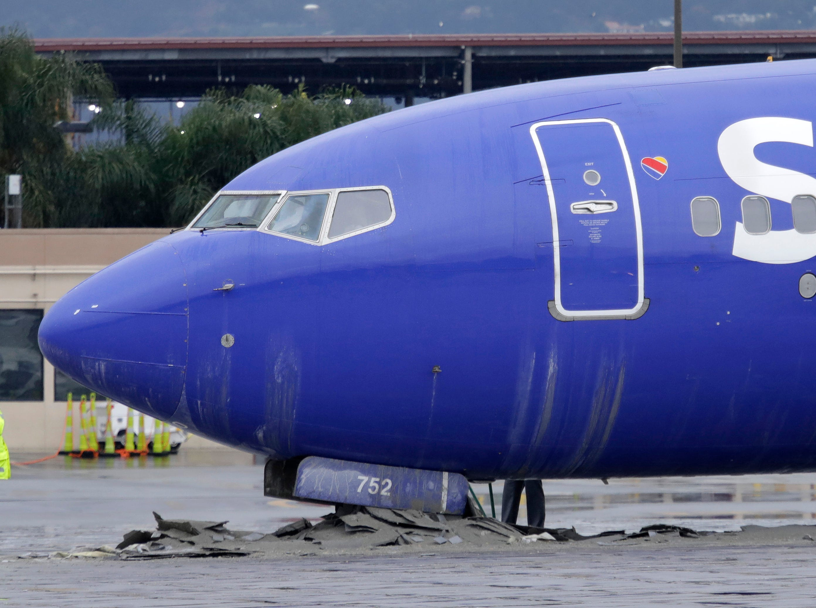 A Southwest Airlines plane slid off the runway at Hollywood Burbank Airport, coming to a stop after its landing gears plowed into a barrier designed to stop the airplane from leaving the runway Thursday, Dec. 6, 2018, in Burbank, Calif. Nobody was hurt when the plane from Oakland skidded off the wet runway as it landed during downpours at the airport north of Los Angeles.