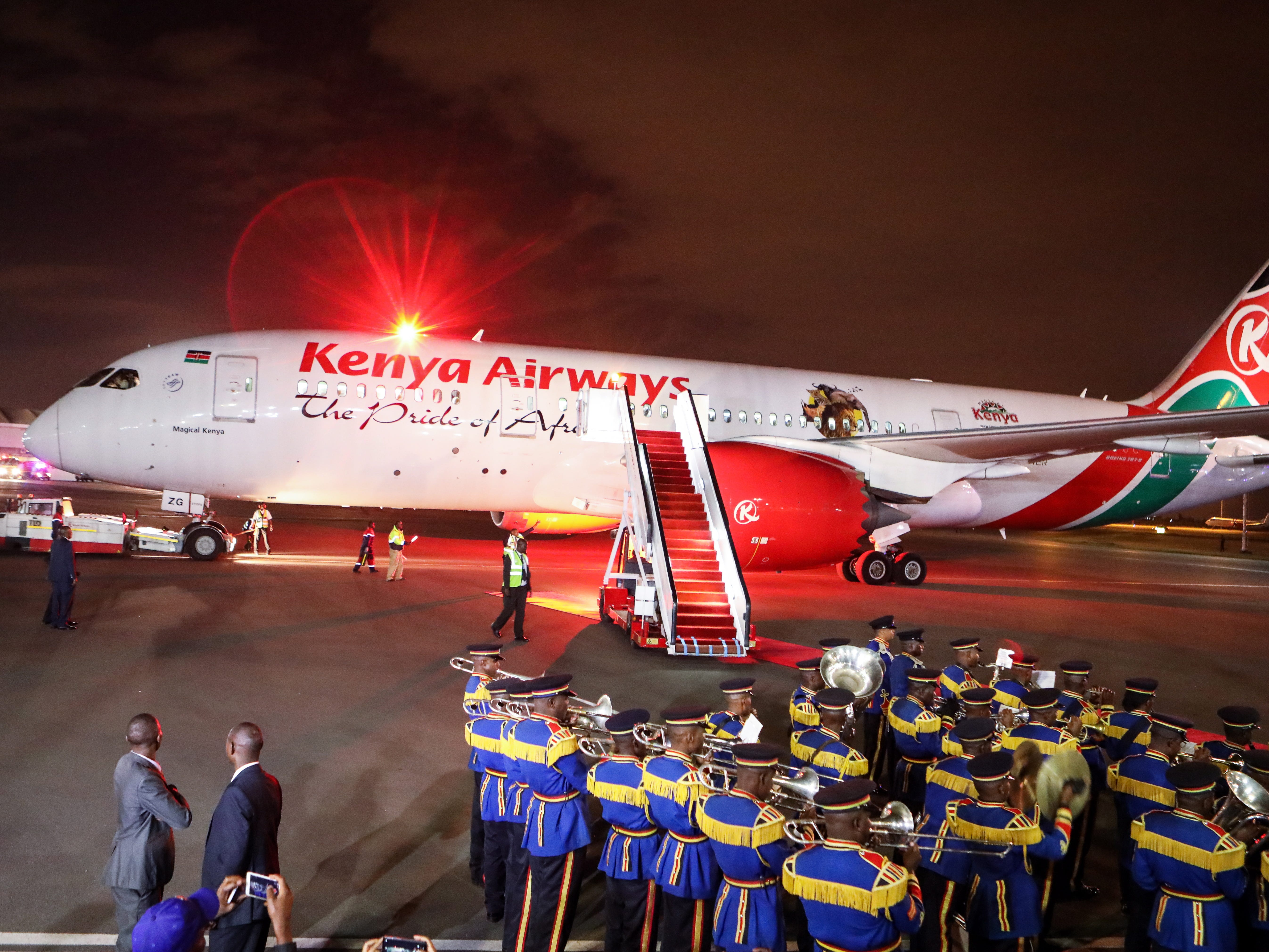 The band for Kenya's Defence Forces band stand in front of a Kenya Airways Boeing 7897 Dreamliner during an event  at the Nairobi airport to officially launch the carrier's first ever non-stop flight from Nairobi to New York City.