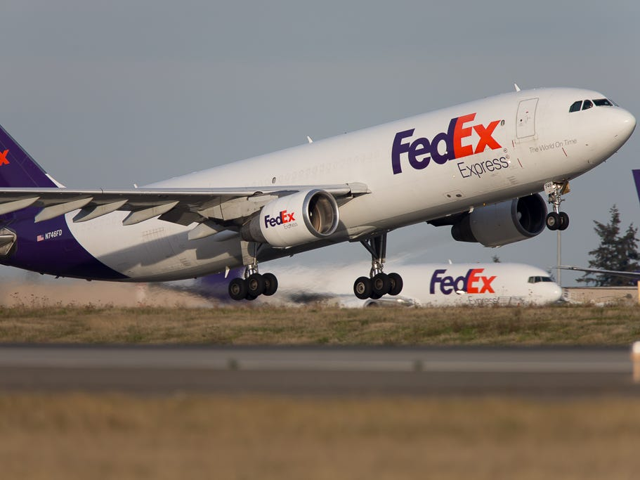 A FedEx Airbus A300F takes off quickly from Seattle-Tacoma International Airport in November 2018.