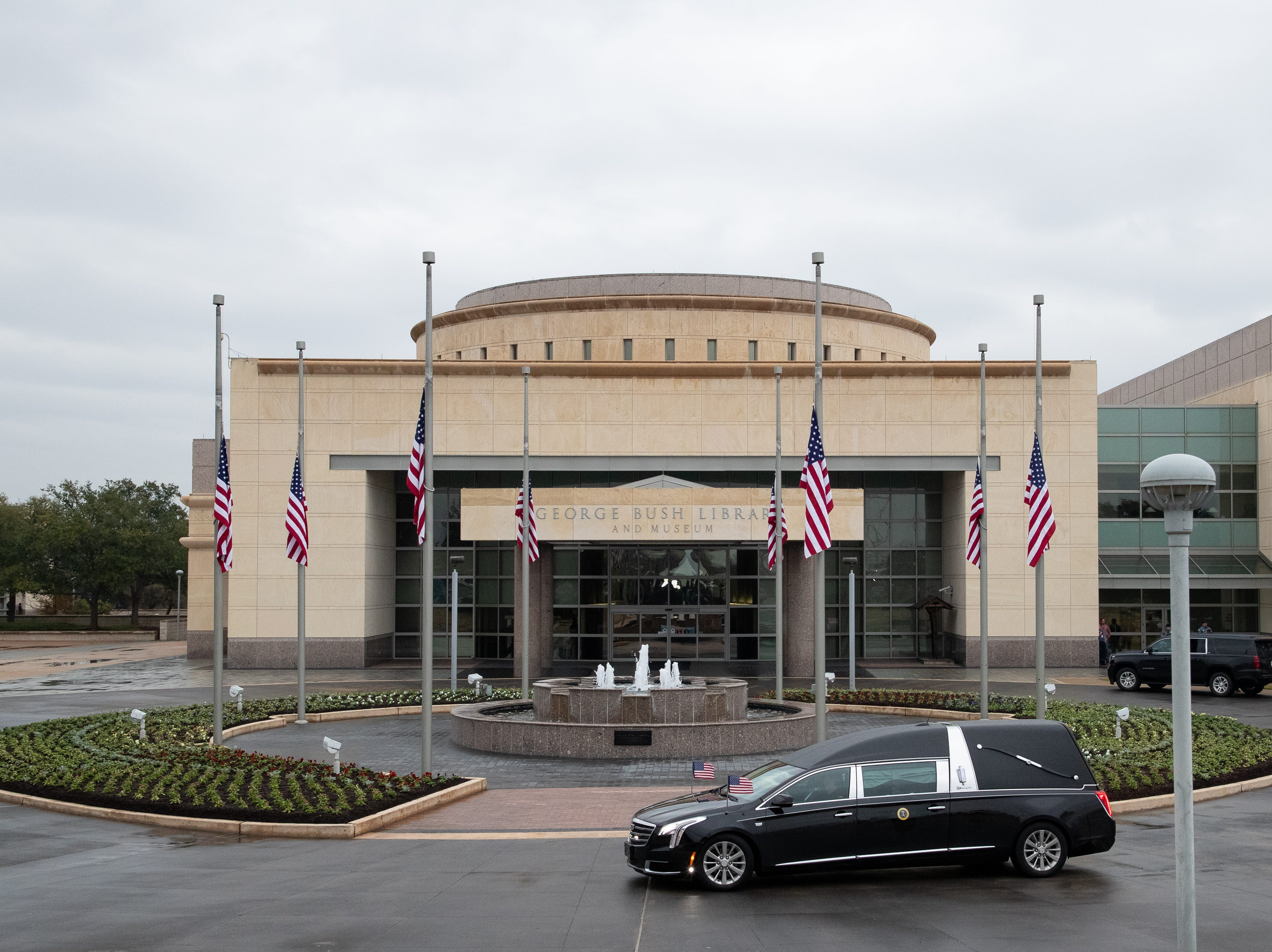 The Hearse carrying the 41st President of the United States, George H.W. Bush, arrives at the George Bush Presidential Library & Museum in College Station on Thursday, Dec 6, 2018.