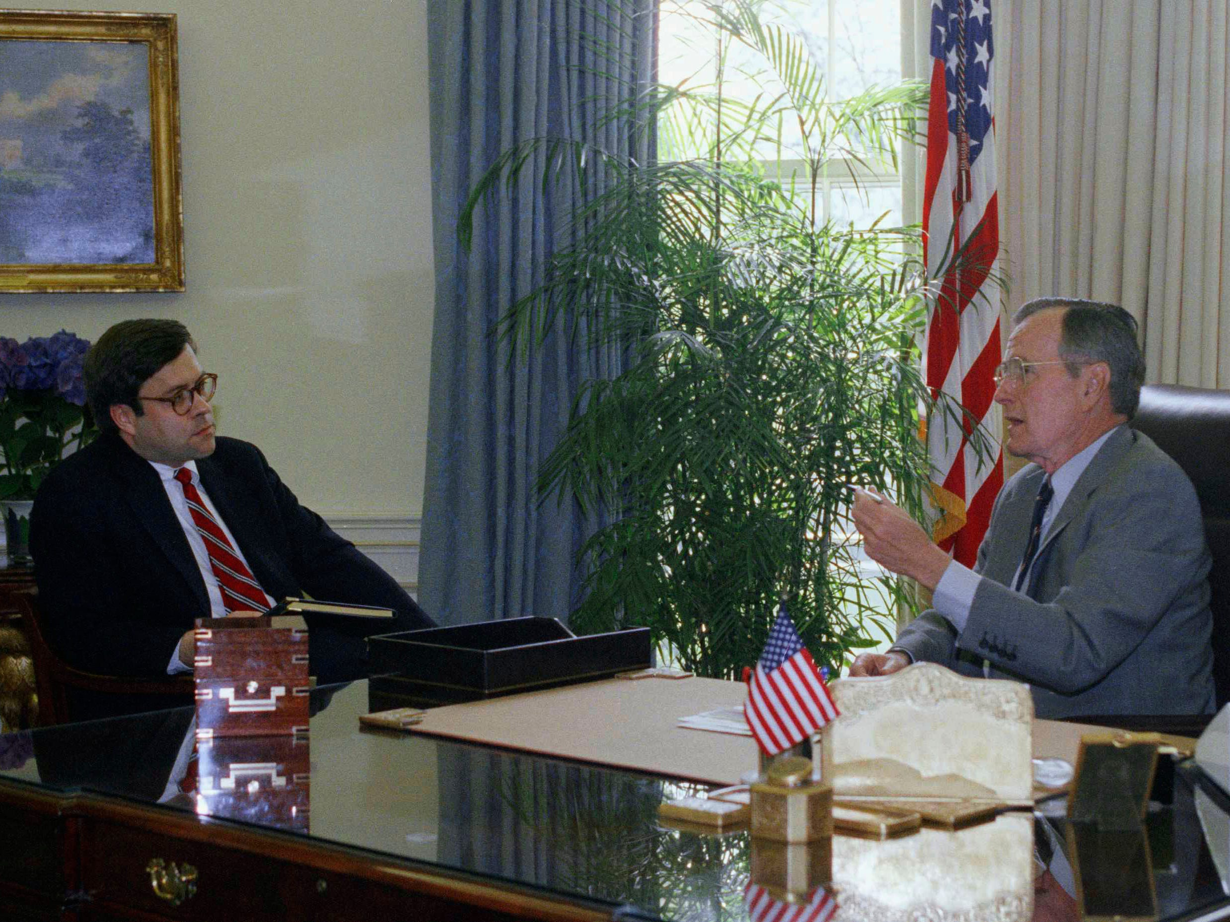 "U.S. President George H. Bush meets with Attorney General William Barr in the Oval Office at morning, Thursday, May 1, 1992 in White House at Washington. In a dramatic change of tone in just a few hours, Bush went from expressing ""frustration and anguish"" over the verdict in the Rodney King case to declaring ""revulsion and pain"" over the violent uprising that terrorized Los Angeles. (AP Photo/Barry Thumma)"