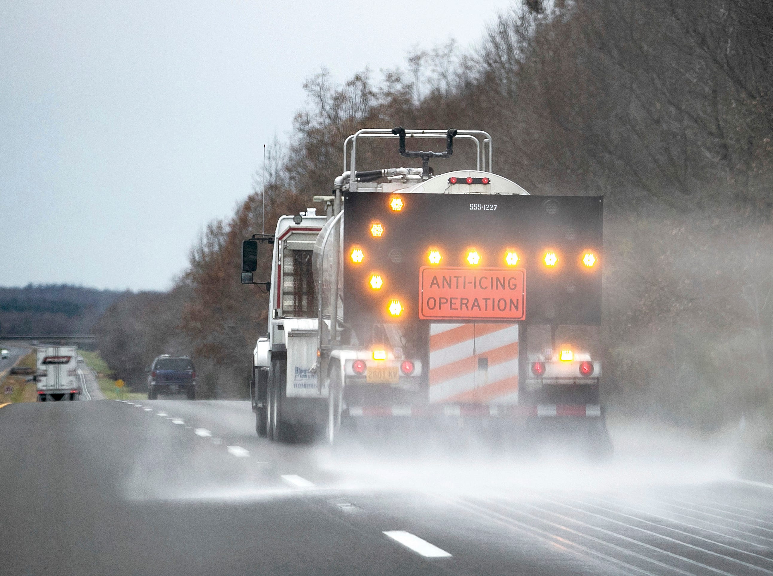 A Kentucky Department of Transportation vehicle sprays salt brine on Highway 45 South near Wingo, Kentucky on Thursday, Dec. 6, 2018. There is potential for a winter storm to hit western Kentucky this weekend. The system is expected to move in late Saturday through Sunday and Monday, but the exact areas of impact and extent of those impacts are still in question.