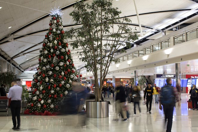 A Christmas tree adds some festive holiday cheer to the Detroit's McNamara terminal in December 2018.