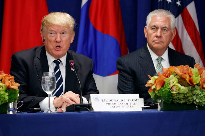 Former Secretary of State Rex Tillerson is pictured alongside President Donald during a luncheon at the Nations General Assembly.