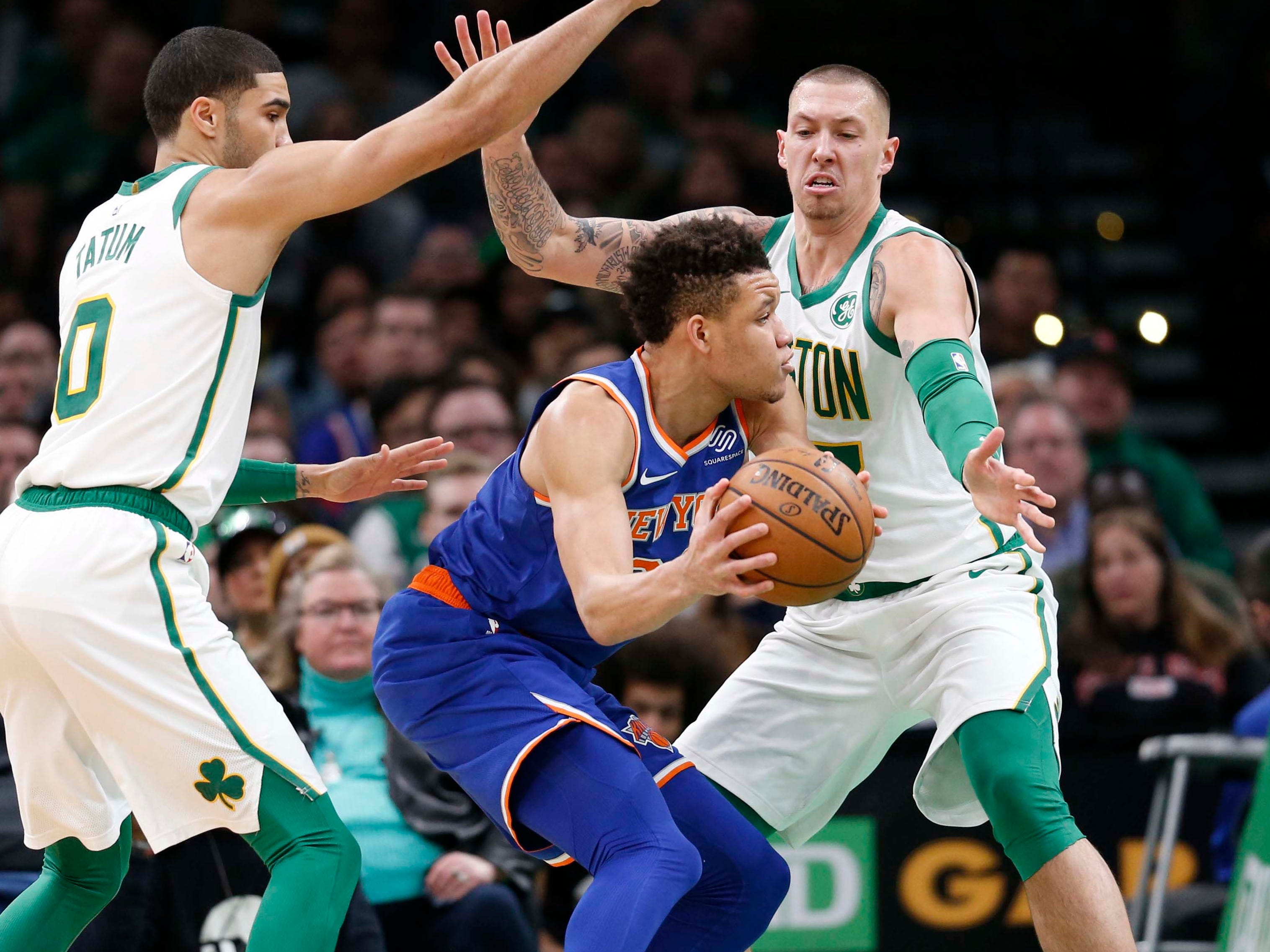 Dec. 6: Knicks forward Kevin Knox (20) tries to pass out of the double-team by Celtics defenders Jayson Tatum (0) and Daniel Theis (27) during the second half in Boston.