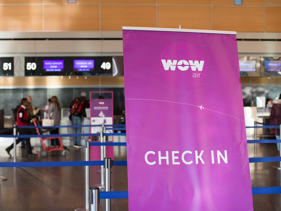 Passengers check in for a WOW Air flight at Boston Logan International Airport in December 2018.