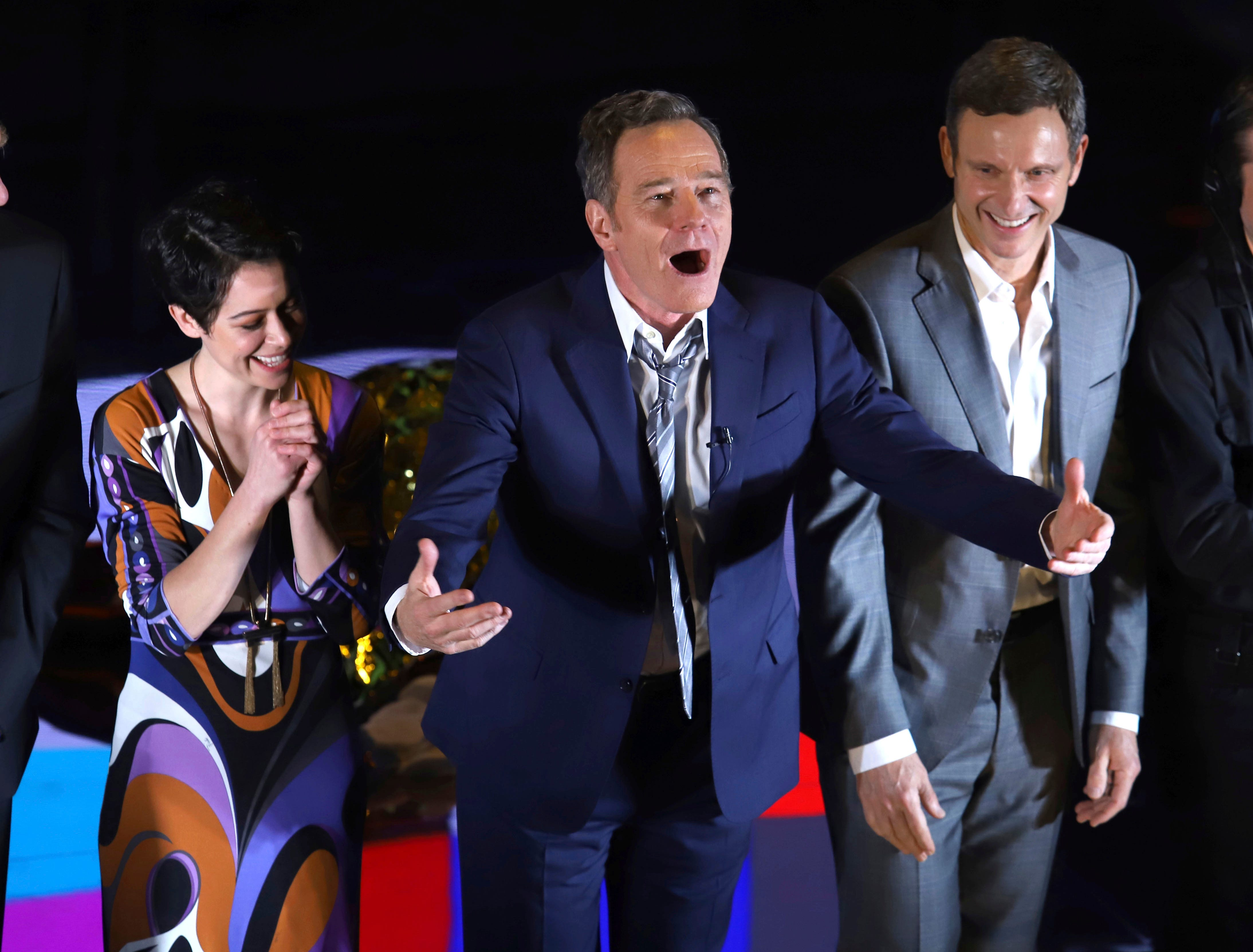 """Bryan Cranston , flanked by Tatiana Maslany and Tony Goldwyn, greets the audience during the curtain call for the Broadway opening night of """"Network"""" at the Belasco Theatre on Thursday, Dec. 6, in New York."""