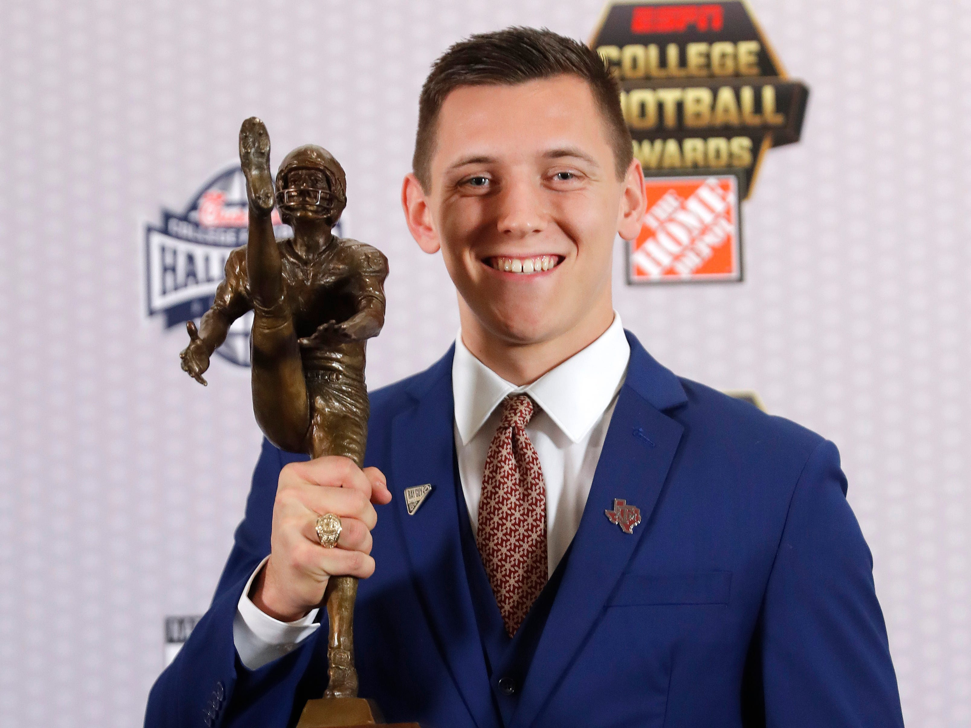 Texas A&M's Braden Mann poses with the trophy after winning The Ray Guy Award for being the top punter in college football.