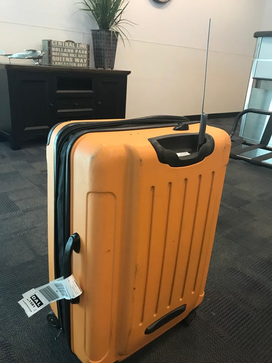 The handle on USA TODAY travel reporter Dawn Gilbertson's suitcase was destroyed on a flight from Phoenix to Dallas.