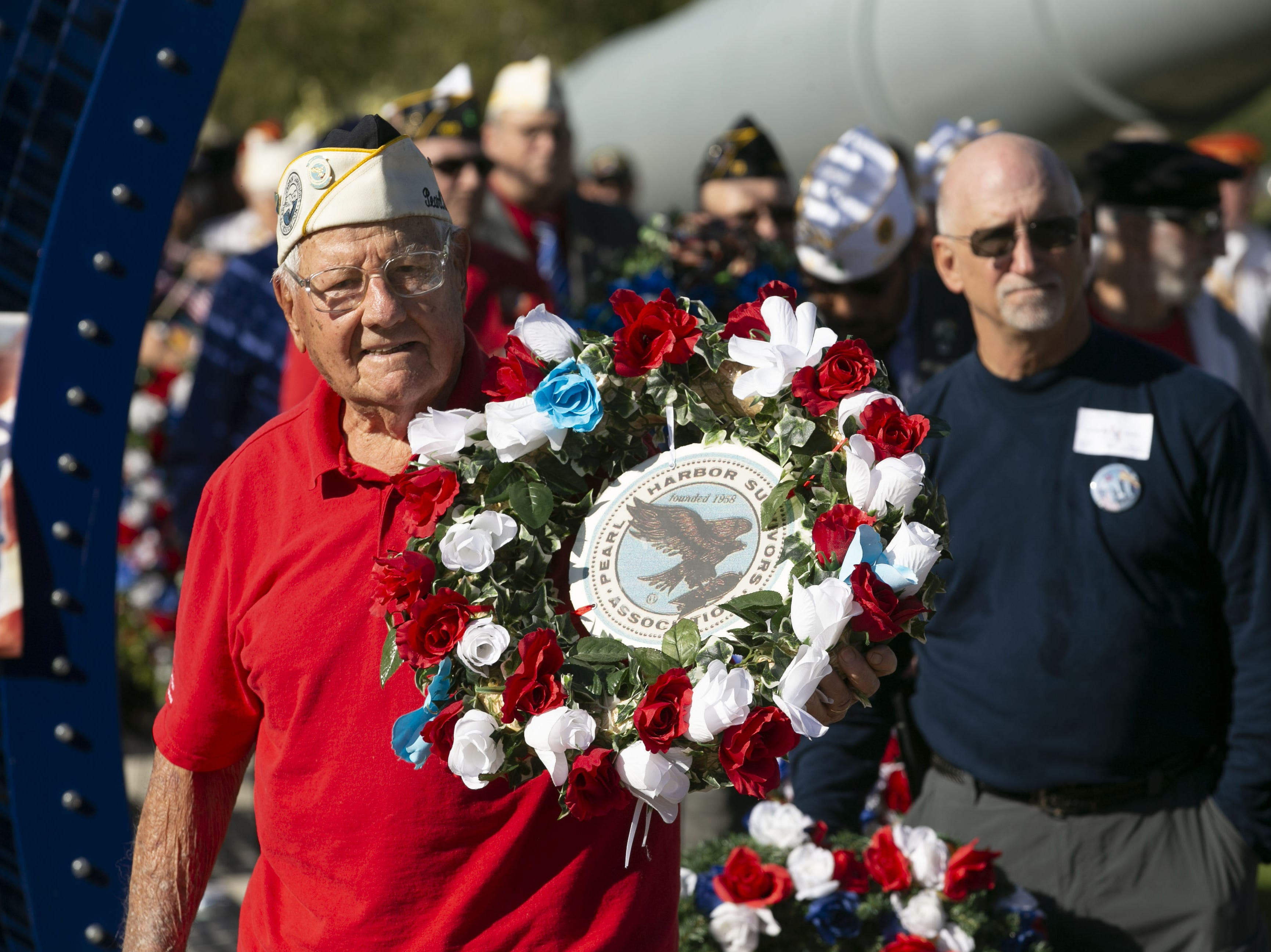 Pearl Harbor survivor Edward Miklavcic of Phoenix, a veteran of the then U.S. Army Air Forces, places a memorial wreath during a Pearl Harbor Remembrance Day event at Wesley Bolin Plaza in Phoenix on the 77th anniversary of the attack on Pearl Harbor, on Dec. 7, 2018.