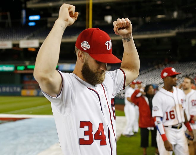Bryce Harper salutes the fans at Nationals Park.