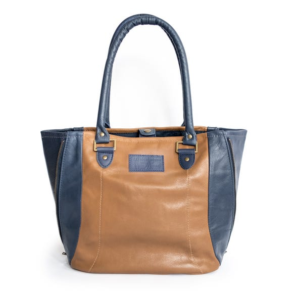 "This tote bag from Looptworks is made from ""upcycled"" leather from Southwest Airlines Boeing 737 seats."