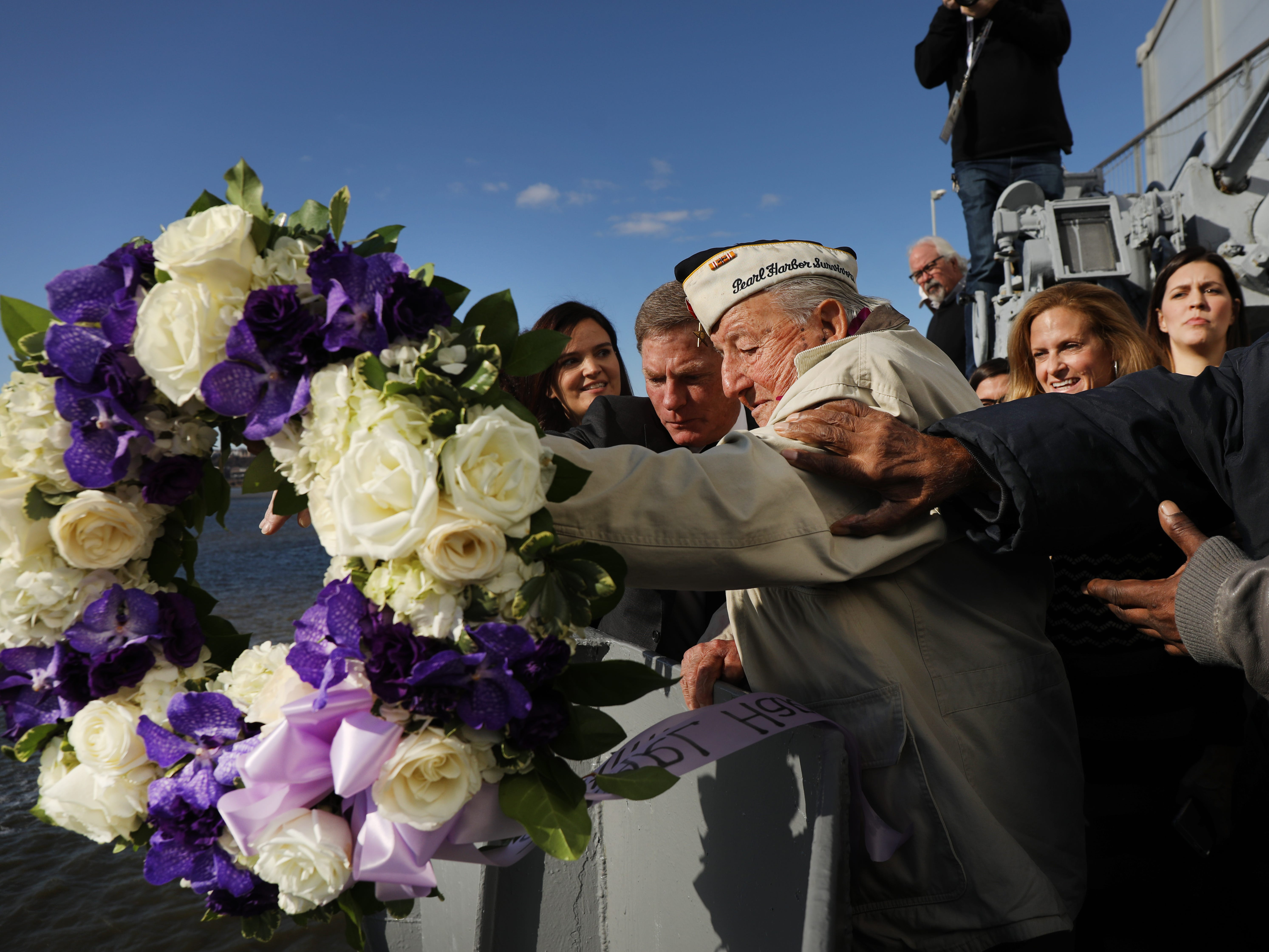 "Local Pearl Harbor survivor Armando ""Chick"" Galella, 97, throws a wreath off of the USS Intrepid at an event marking the 77th Anniversary of the attack on Pearl Harbor on Dec. 07, 2018 in New York City. Japanese bombers attacked Pearl Harbor on December 7, 1941 resulting in the deaths of 1,177 crew members on the US Arizona. The attack prompted the United States to declare war on Japan and shortly after Germany."