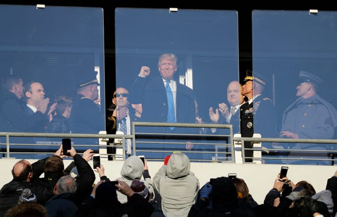 Then President-elect Donald Trump acknowledges spectators during the first half of the Army-Navy game in Baltimore in 2017. President Trump will attend the Army-Navy football game, Saturday, Dec. 8, 2018, in Philadelphia.