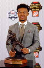 Oklahoma quarterback Kyler Murray poses after winning The Davey O'Brien Award for being the top quarterback in college football.