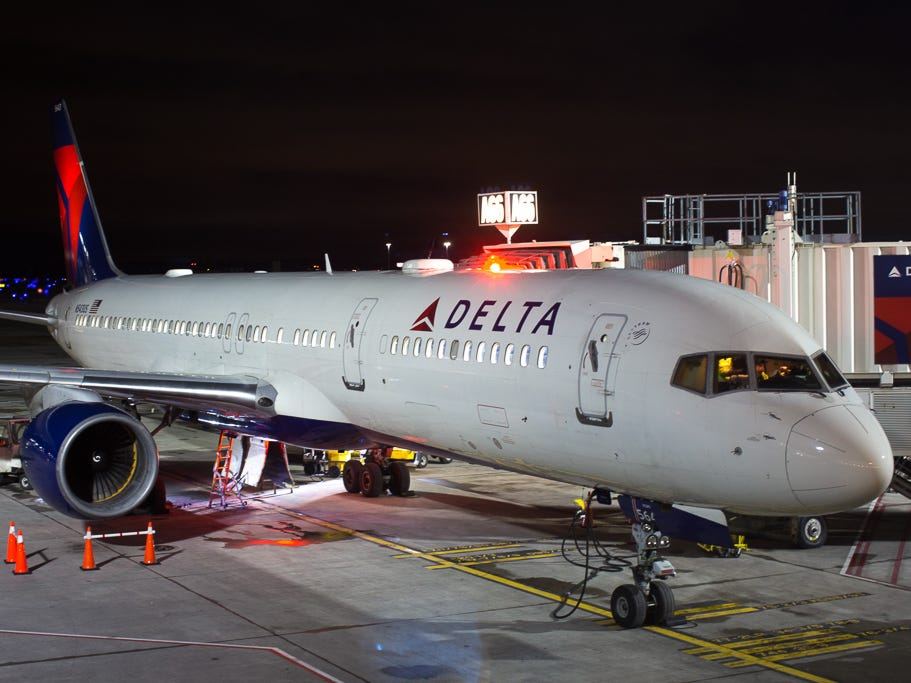 A Delta Air Lines Boeing 757-200 receives some attention from mechanics at the gate at Detroit International Airport in December 2018.