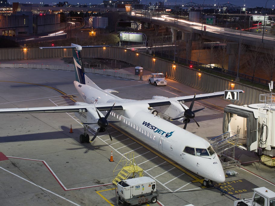A WestJet Bombardier Q400 awaits its next flight at Boston Logan International Airport in November 2018.