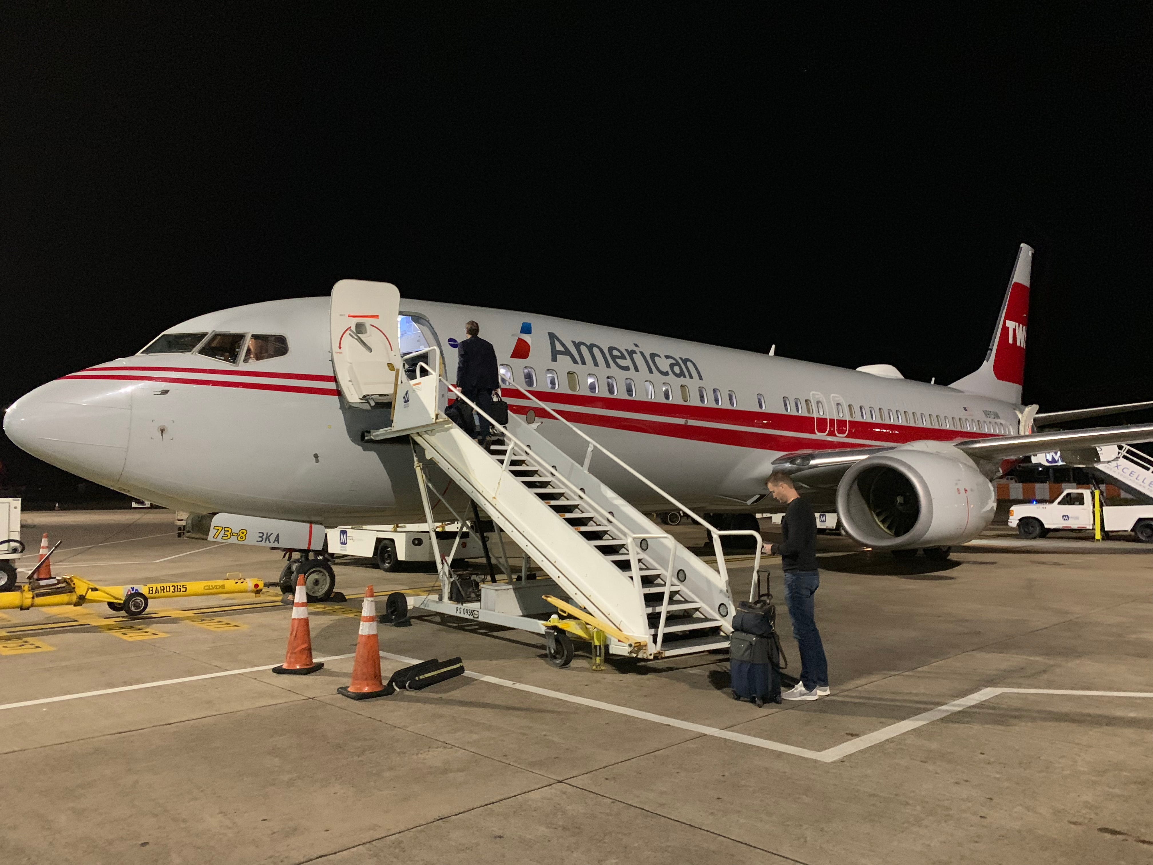 American's specially painted TWA 'retro livery' boards passengers in Bermuda on Nov. 12, 2018.