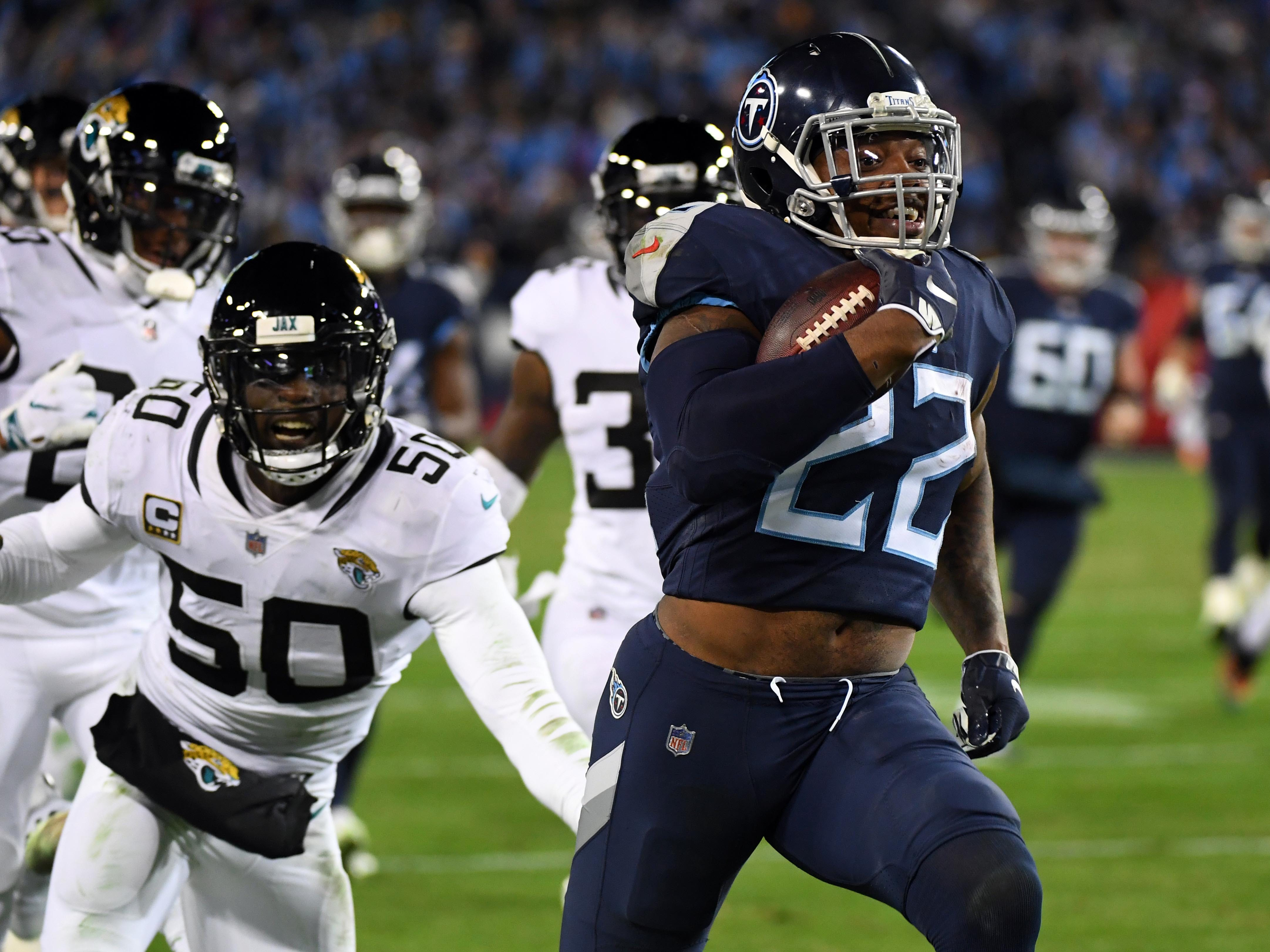 Tennessee Titans running back Derrick Henry runs for a touchdown during the second half against the Jacksonville Jaguars at Nissan Stadium.