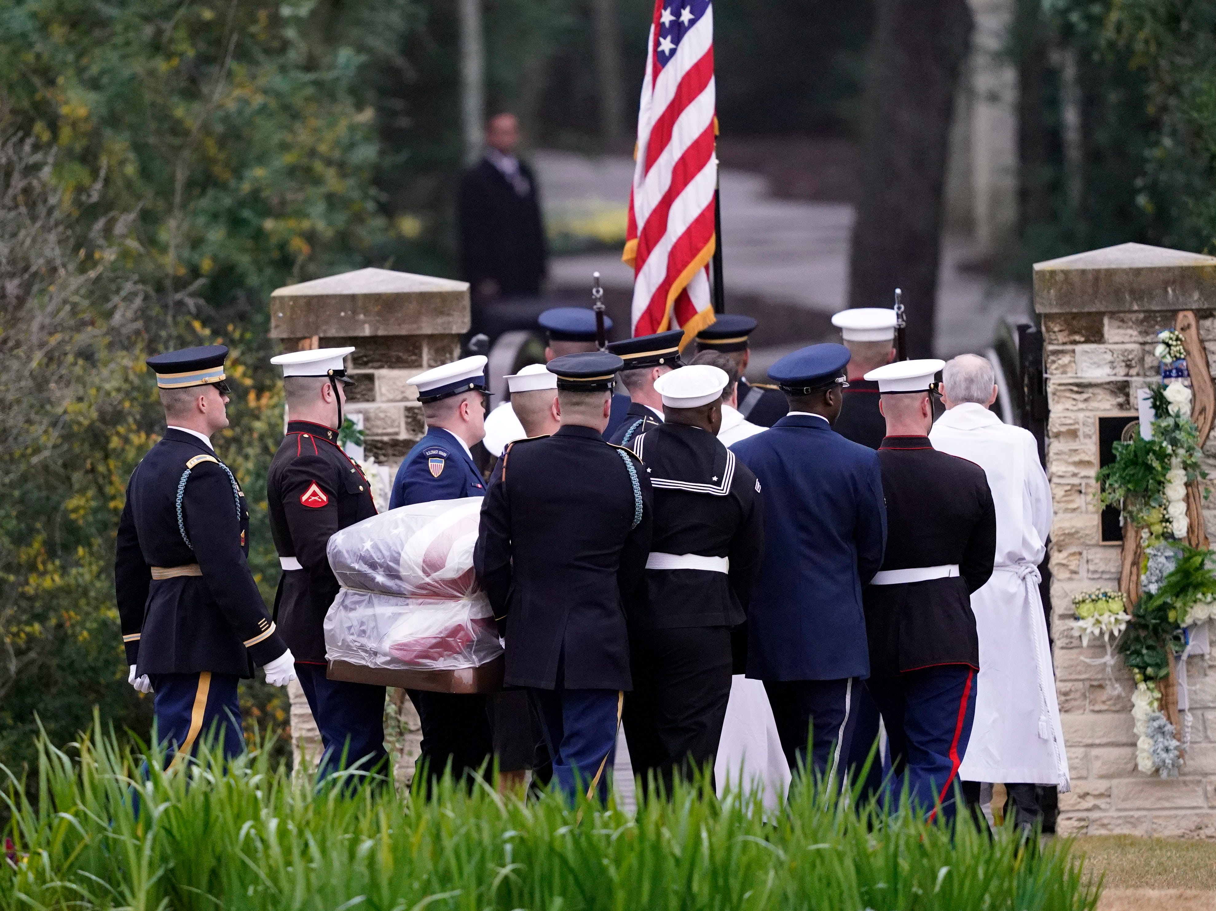 The flag-draped casket of former President George H.W. Bush is carried by a joint services military honor guard for burial at the George H.W. Bush Presidential Library and Museum on Dec. 6, 2018 in College Station, Texas. President Bush will be buried at his final resting place at the George H.W. Bush Presidential Library at Texas A&M University in College Station, Texas. A WWII combat veteran, Bush served as a member of Congress from Texas, ambassador to the United Nations, director of the CIA, vice president and 41st president of the United States.