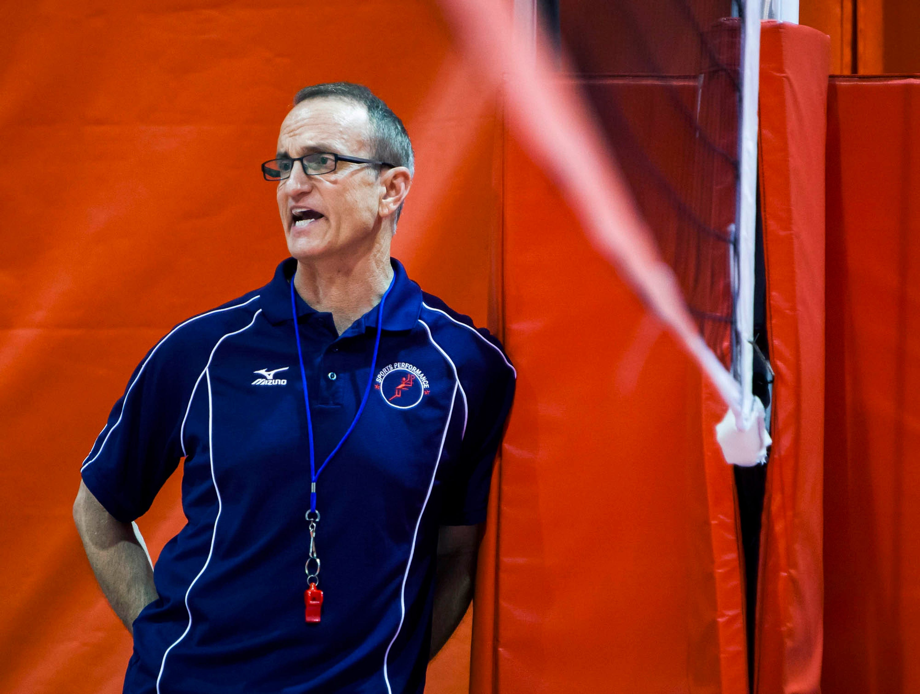 Longtime volleyball coach Rick Butler watches a scrimmage at a camp in Lincoln, Neb., in 2014.