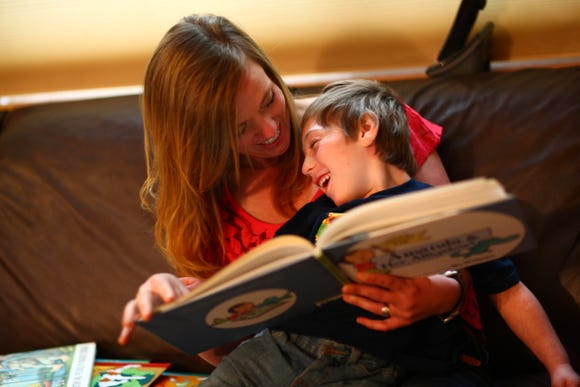 Babysitter Samantha McLeod reads with 5 year old Brian Quayle at the Quayle home.