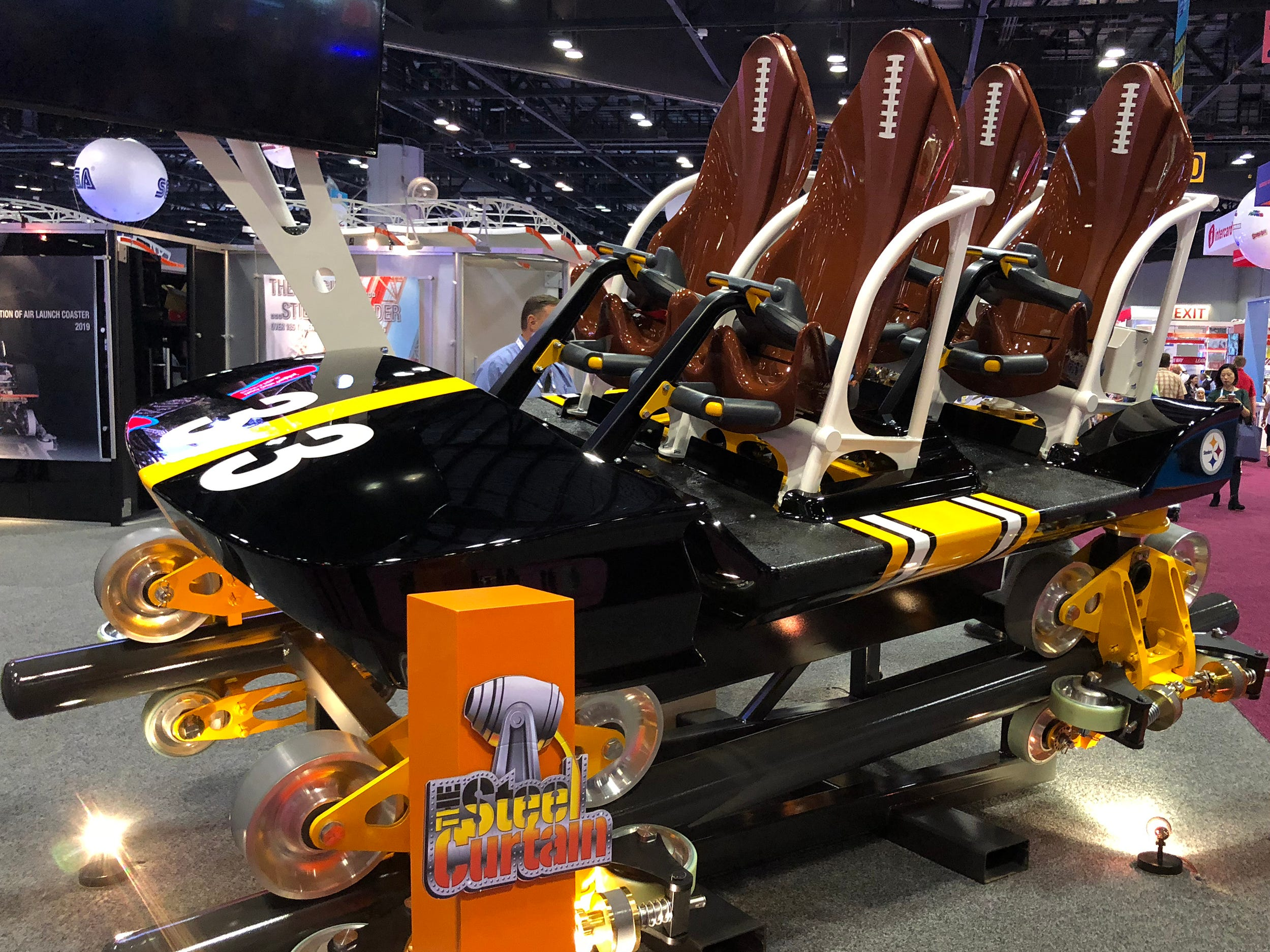 Expo attendees got to see football-inspired seats and the Pittsburgh Steelers' distinctive black and gold colors when S&S Sansei Technologies offered a first look at the lead car for the Steel Curtain, the 220-foot-tall, 75 mph behemoth coming to the Pennsylvania amusement park, Kennywood.