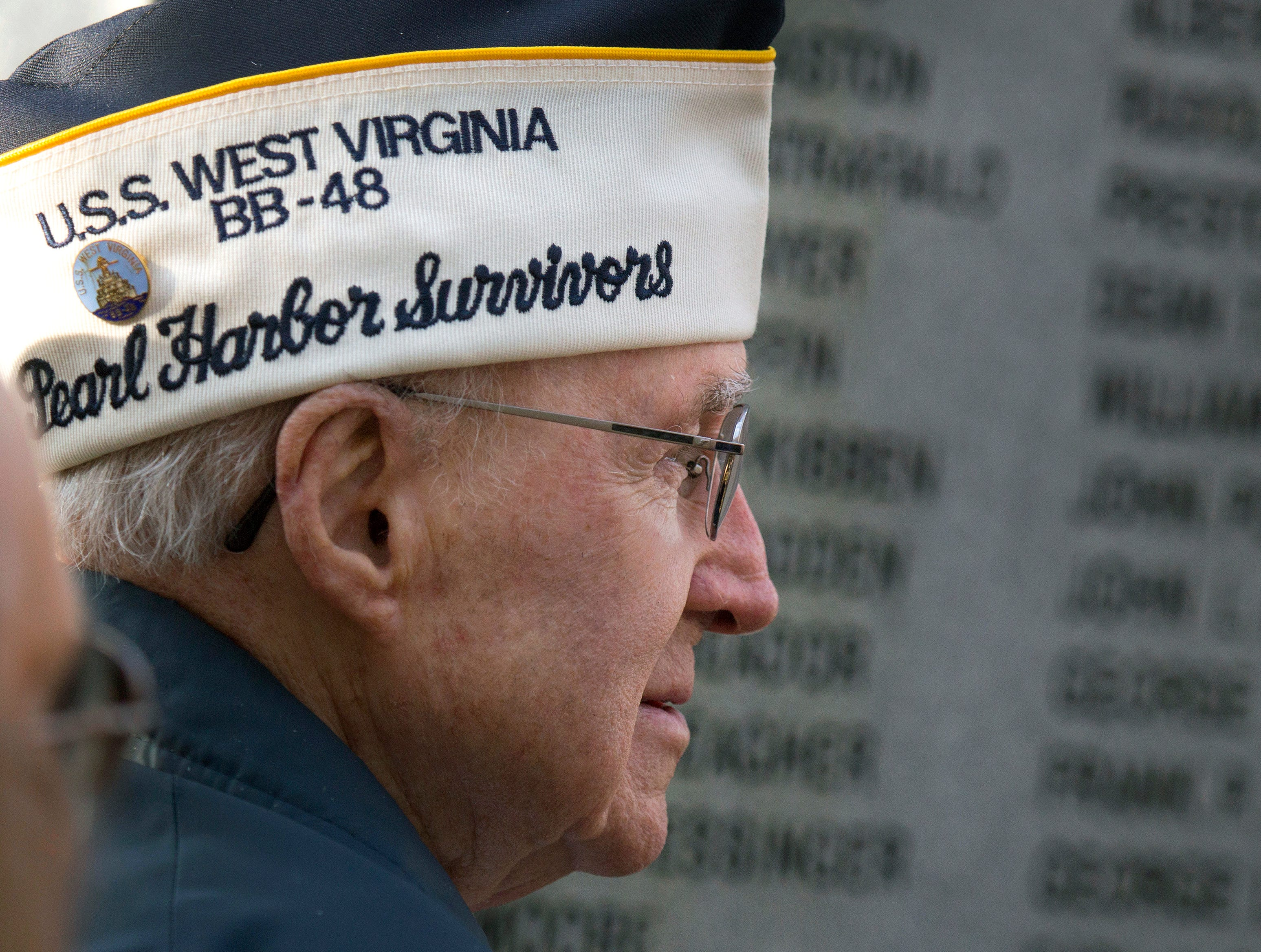 Paul J. Moore, the last remaining local member of the Pearl Harbor Survivors Association, Tidewater Chapter 2 organization, stands next to the Pearl Harbor Memorial during the annual Pearl Harbor Survivors Remembrance Ceremony, at Joint Expeditionary Base Little Creek-Fort, Friday, Dec. 7, 2018, in Virginia Beach, Va.