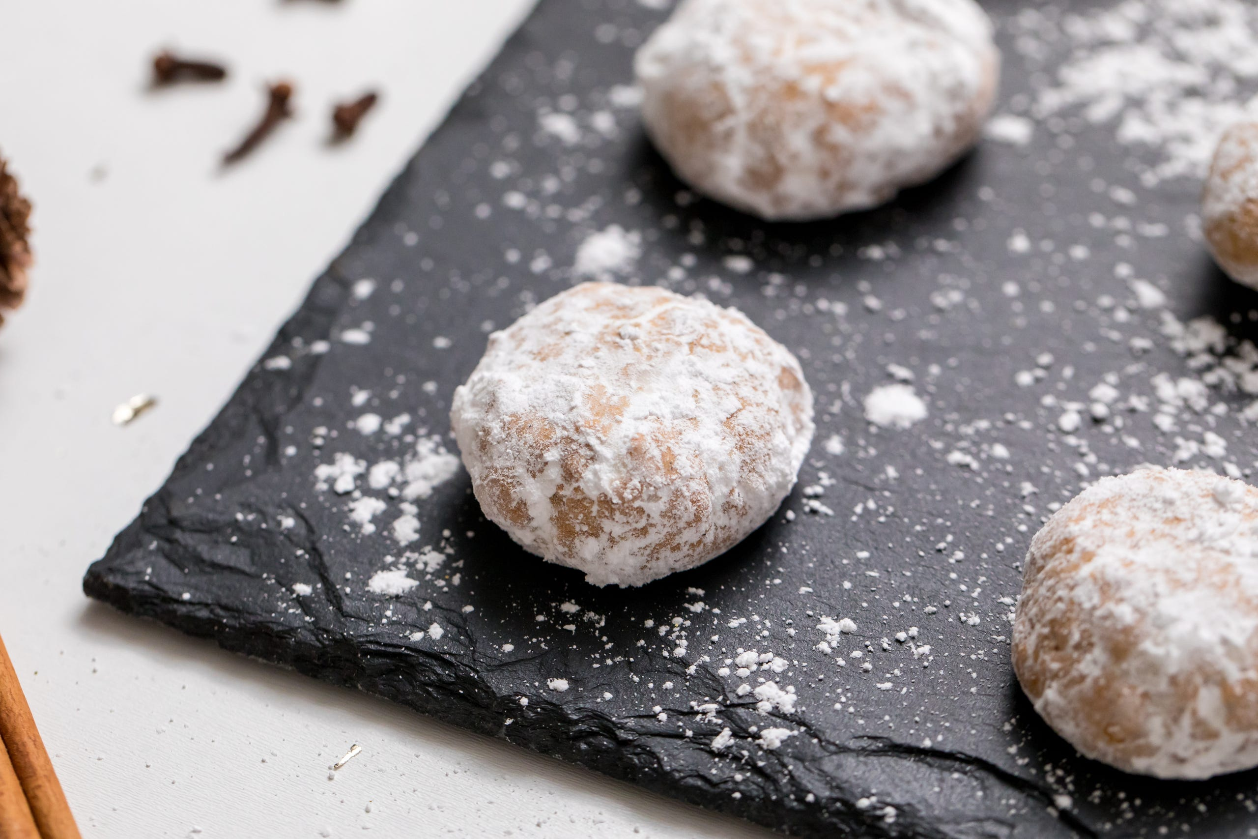 """These<a href=""""https://www.thanksgiving.com/recipes/christmas-cookies/gluten-free-and-vegan-chai-spiced-snowball-cookies?utm_source=usatchristmascookieggallery"""" target=""""_blank"""">chai-spiced snowball cookies</a>, inspired by<a href=""""http://cafejohnsonia.com/2013/12/chai-spiced-snowball-cookies-gluten-free-and-vegan.html"""" rel="""
