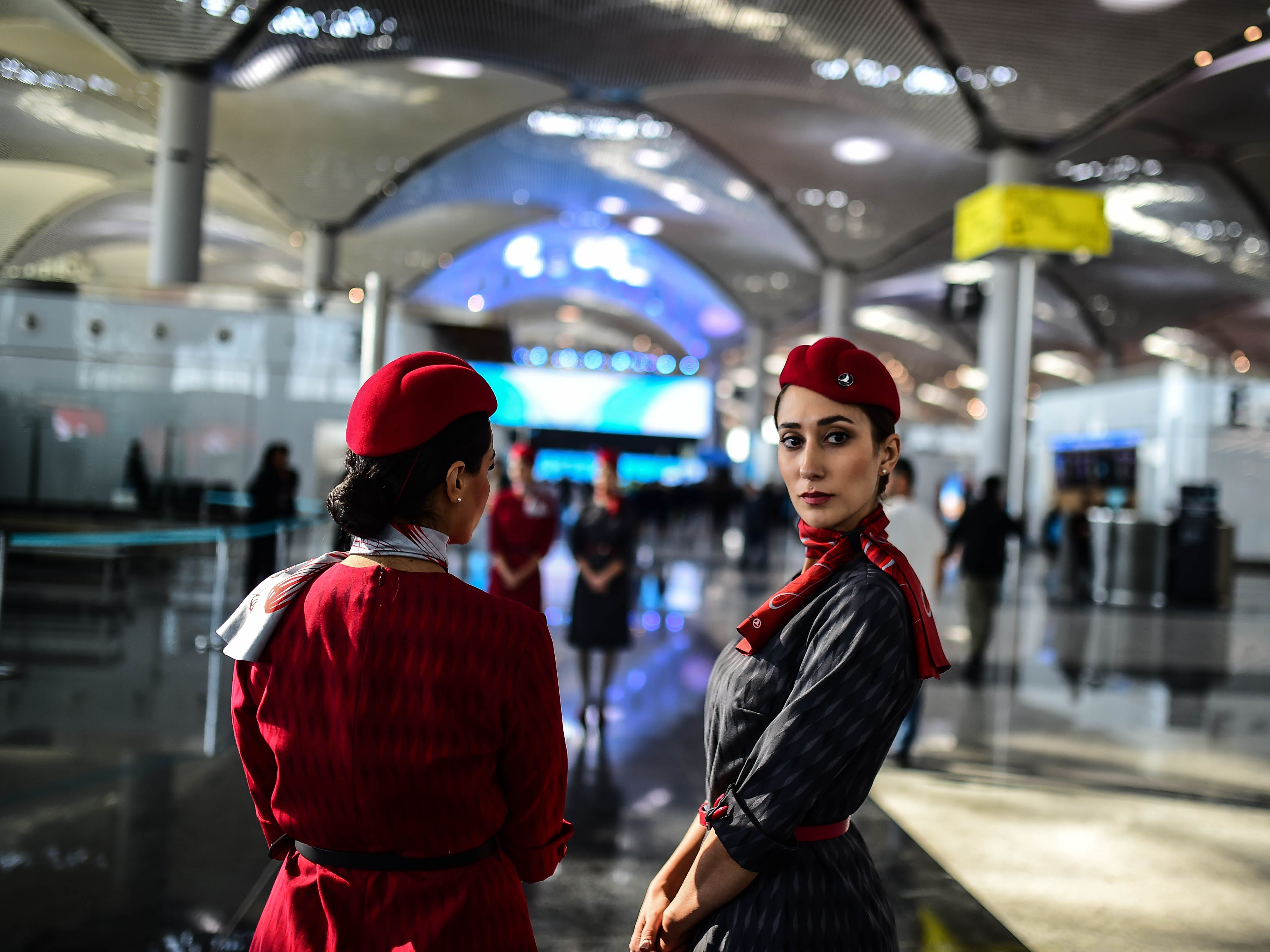 Turkish Airlines flight attendants wait prior to the official opening ceremony of the first phase of Istanbul's new airport on Oct.  29, 2018 in Istanbul, Turkey.
