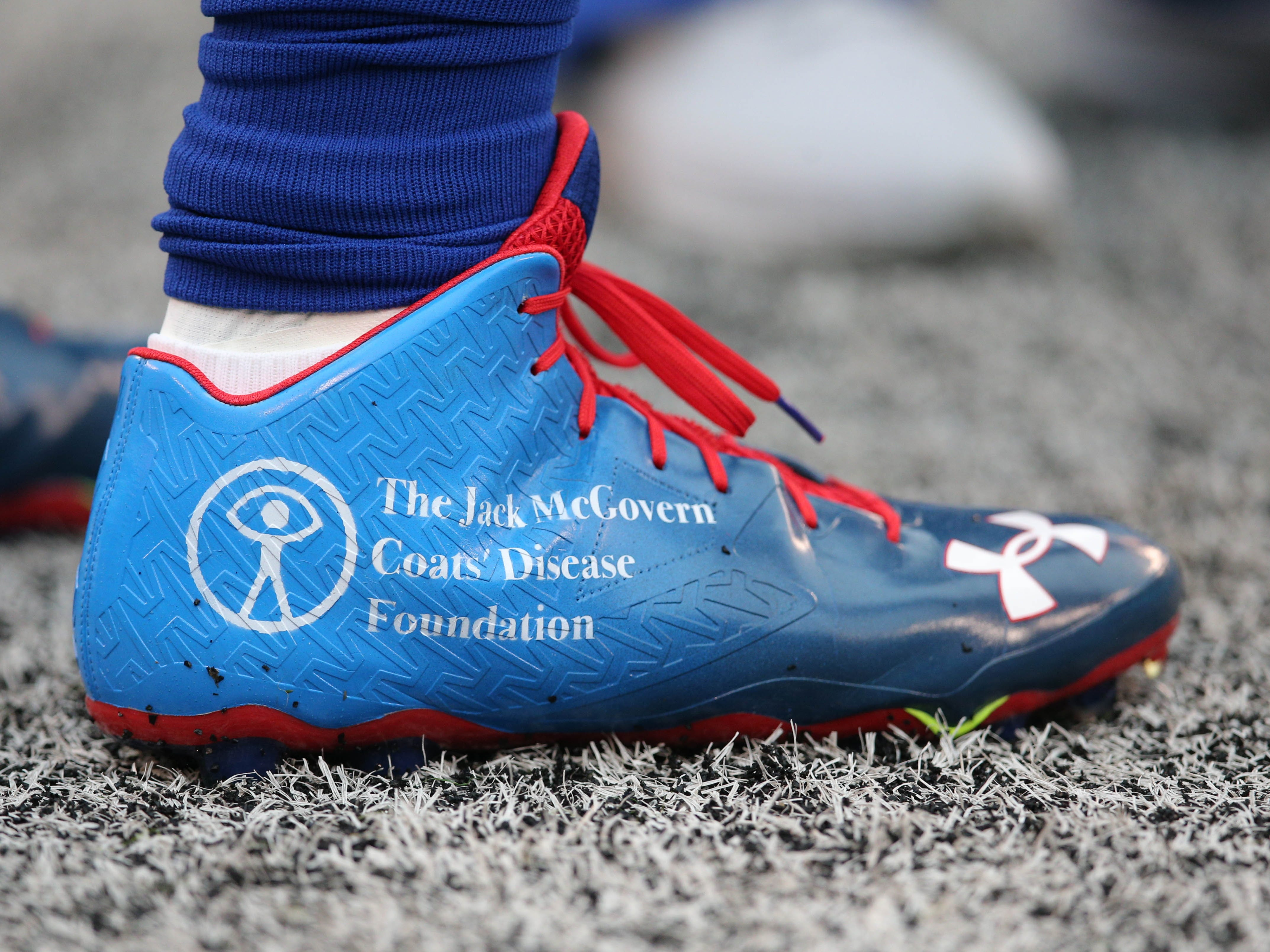 New York Giants linebacker Olivier Vernon wears special cleats before a game against the Chicago Bears at MetLife Stadium.