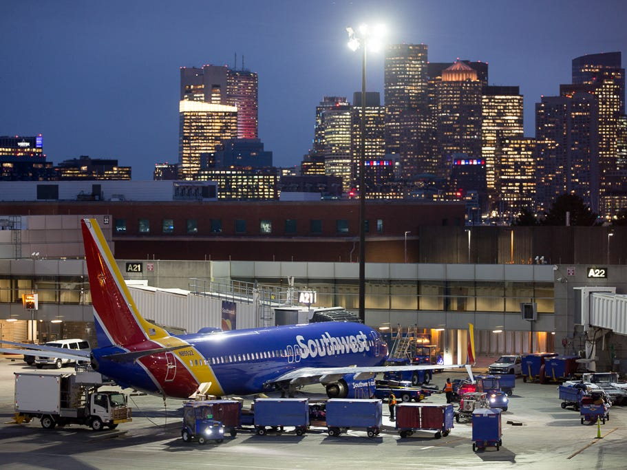 The Boston skyline rises up above a Southwest Airlines Boeing 737-800 at Boston Logan International Airport in November 2018.