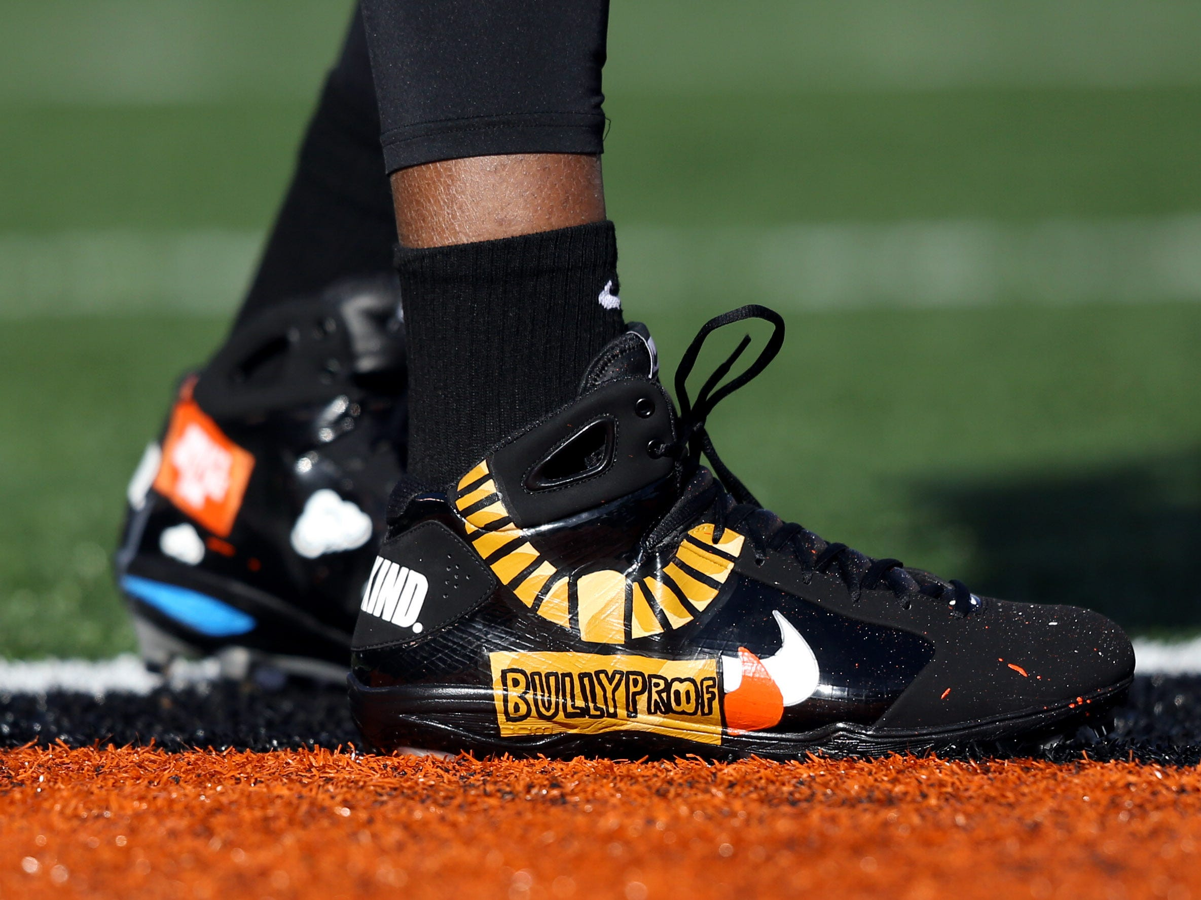 Cincinnati Bengals defensive end Carlos Dunlap shoes for My Cause My Cleats during warmups prior to the game against the Denver Broncos at Paul Brown Stadium.