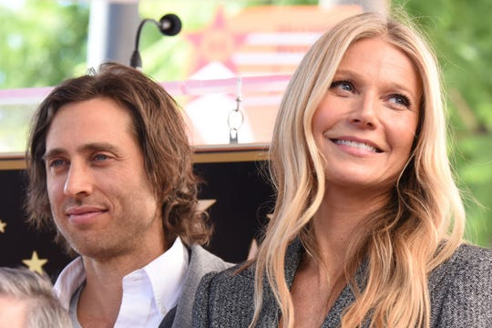 Gwyneth Paltrow and producer Brad Falchuk attend the Hollywood Walk of Fame star unveiling ceremony for producer/director Ryan Murphy, December 4, 2018 in Hollywood, California.