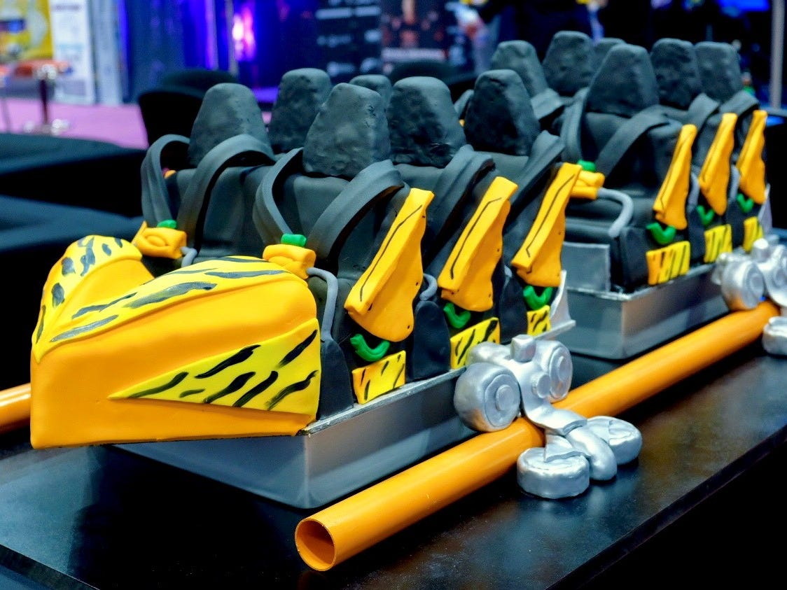 Instead of actual cars, attraction manufacturer Premier Rides revealed a cake in the likeness of the Tigris coaster it is creating for Busch Gardens Tampa Bay in Florida. The triple-launch ride will soar 150 feet and hit 62 mph.