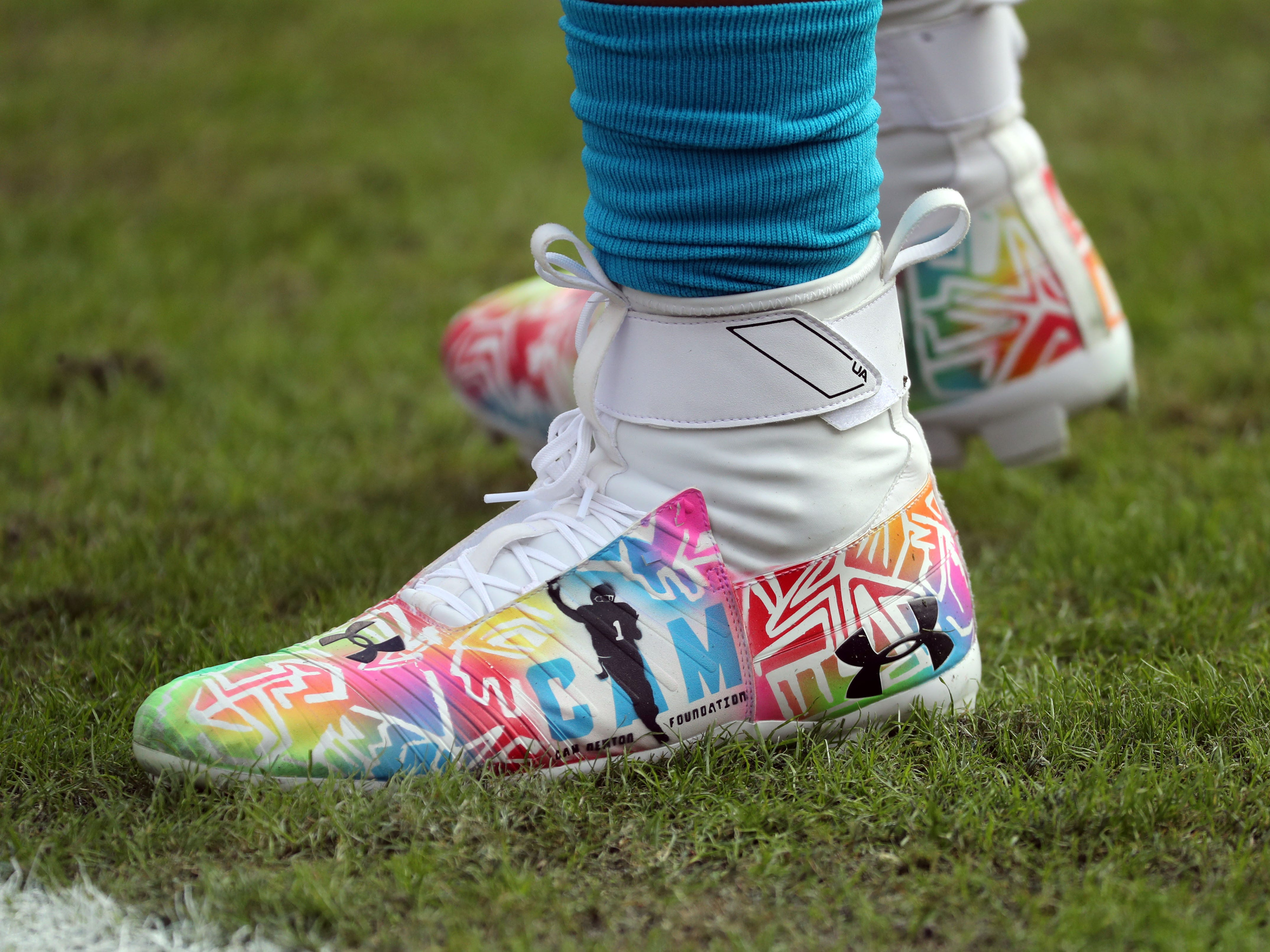 A detailed view of Carolina Panthers quarterback Cam Newton (1) cleats prior to the game against the Tampa Bay Buccaneers at Raymond James Stadium.