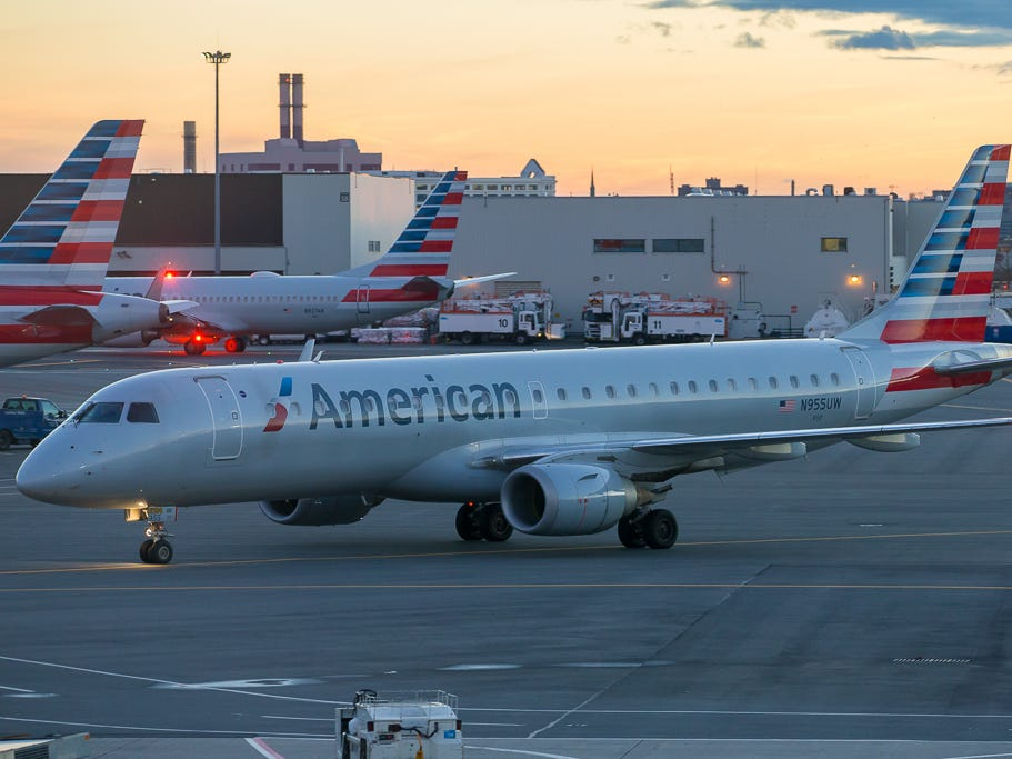 A rare American Airlines Embraer E190 taxis into a gate at Terminal B at Boston Logan International Airport in December 2018.